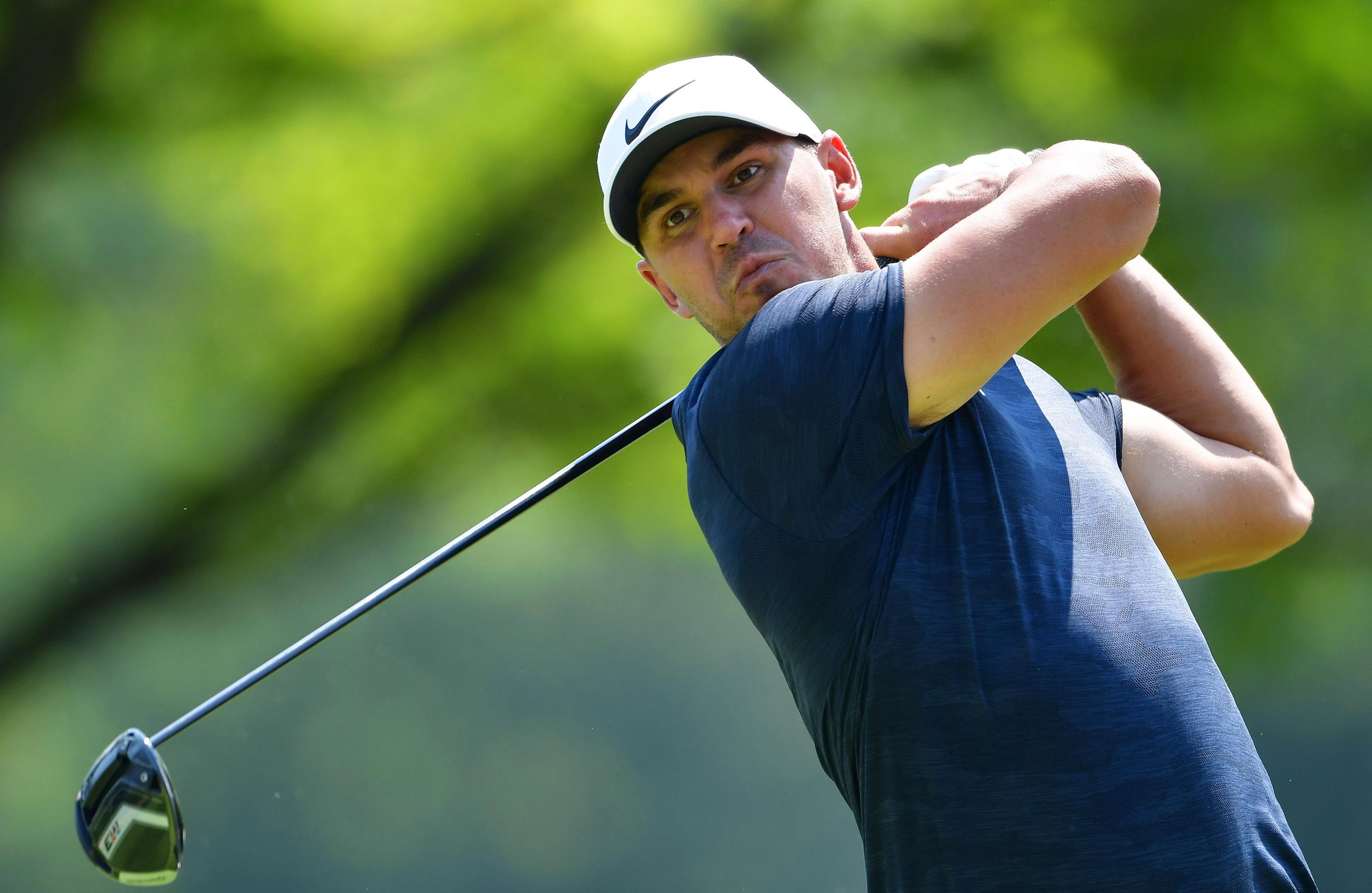 Muscleman Brooks Koepka roared up the leaderboard with a record-equalling round of 63