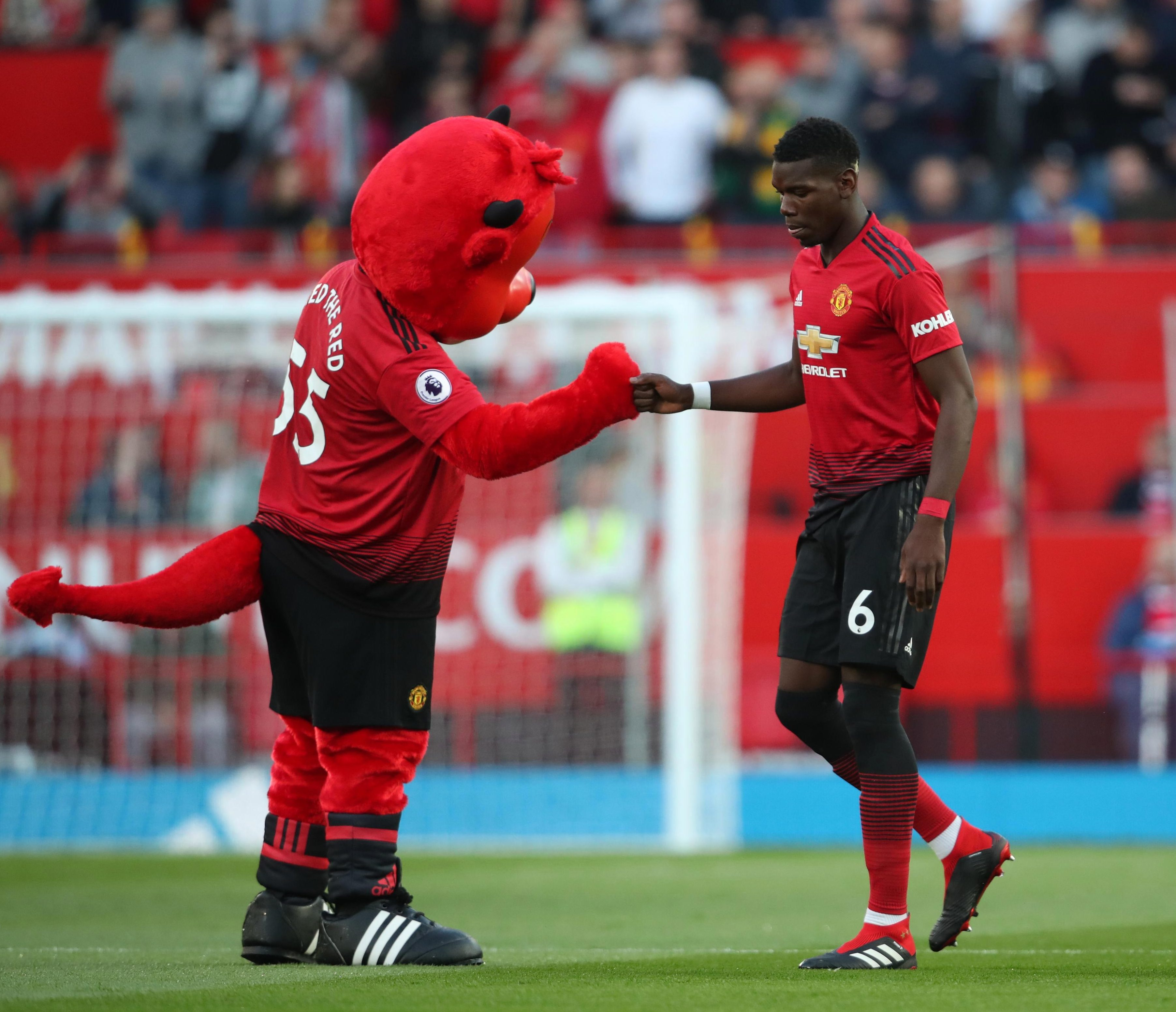 Fred the Red greets Paul Pogba onto the Theatre of Dreams