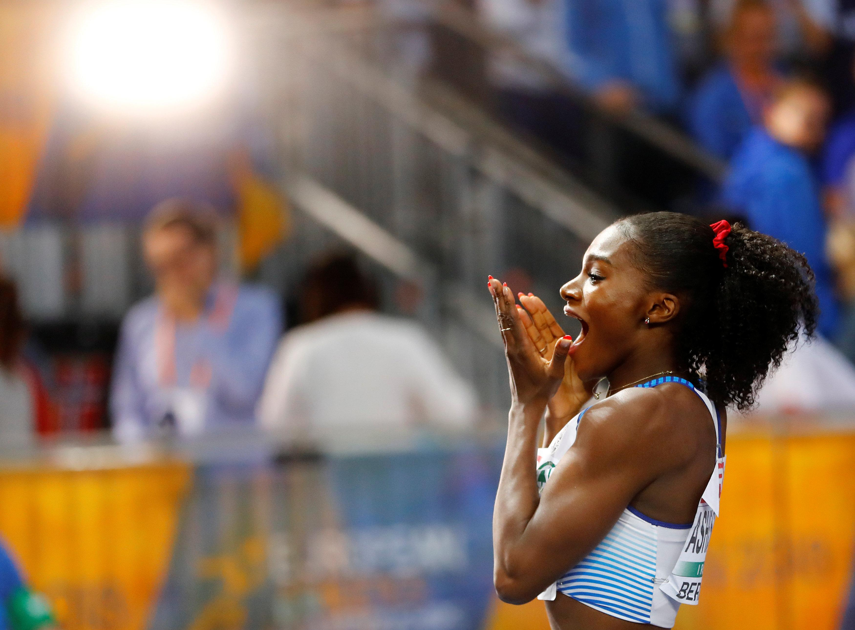 Dina Asher-Smith looked shocked as she completed a famous golden double