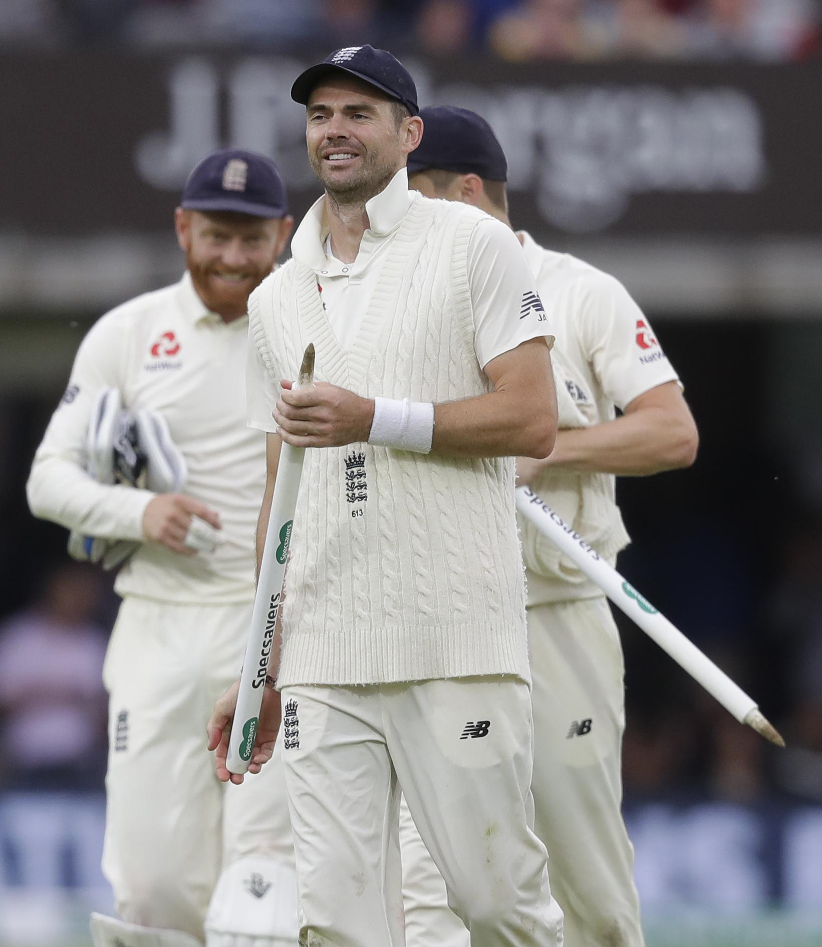 James Anderson leaves with a stump after taking four wickets as India were dismissed for just 130 to seal a huge victory for England at Lord's