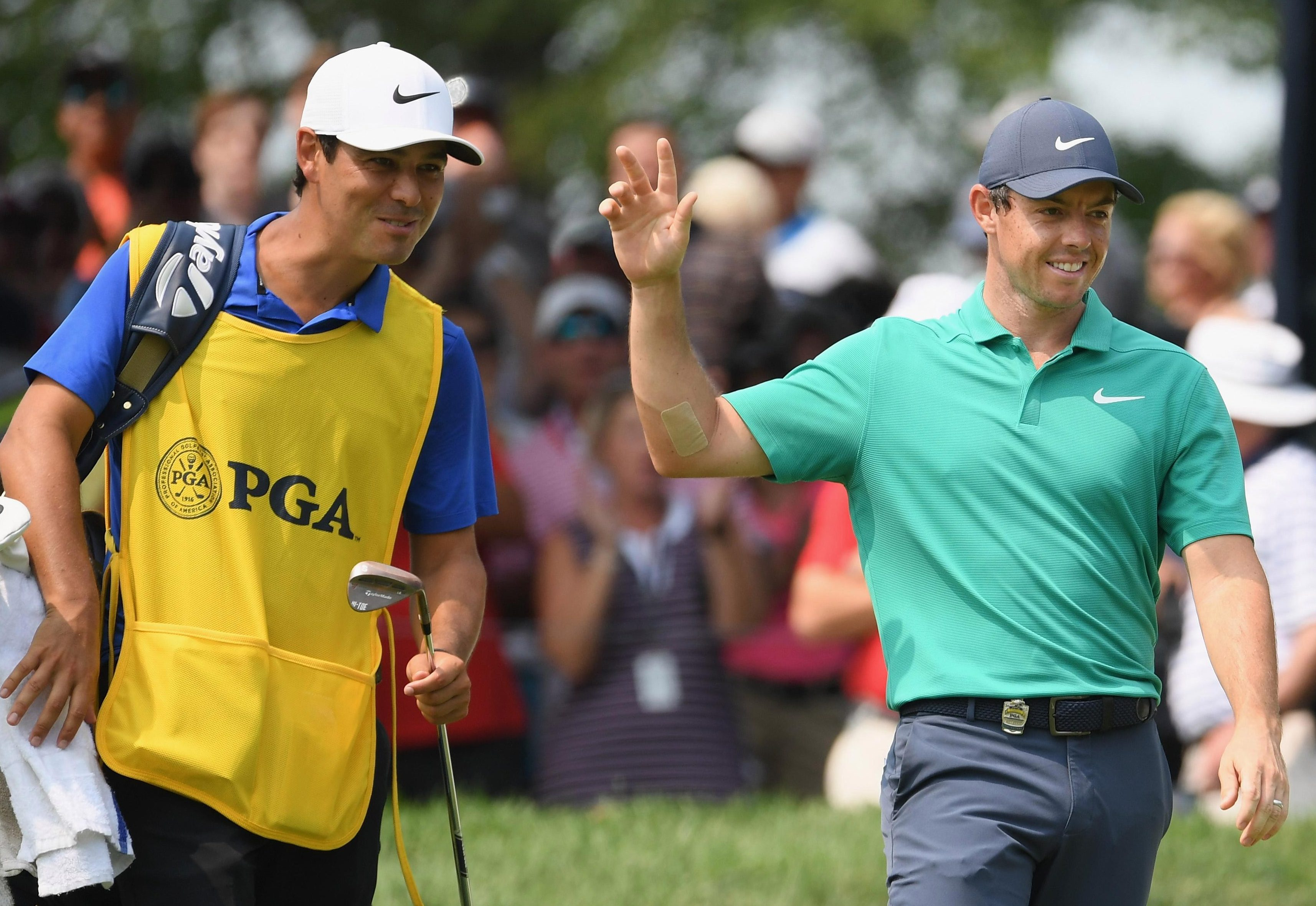 Rory McIlroy celebrates with caddy Harry Diamond