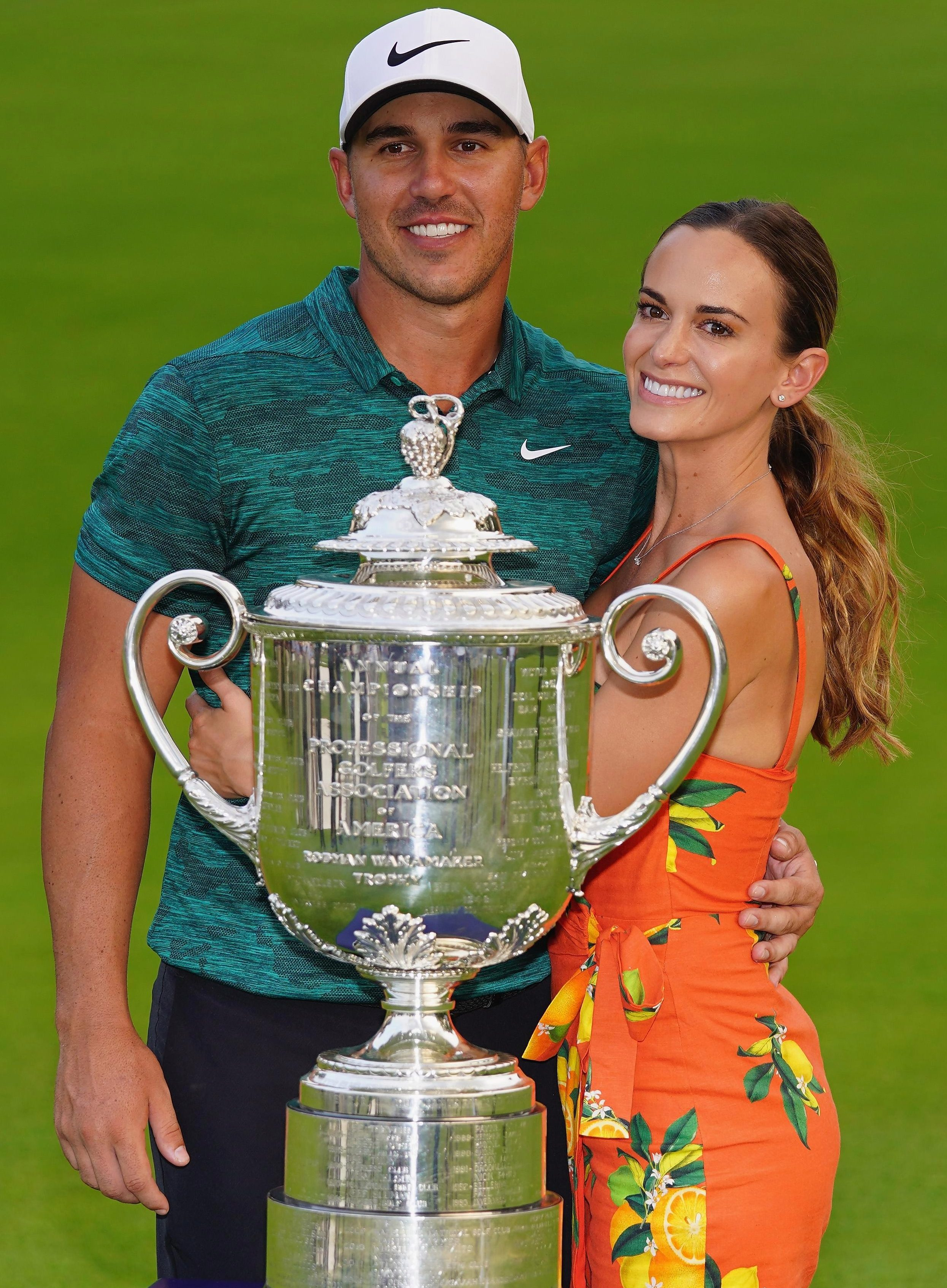 Girlfriend Jena Sims helps fellow American Brooks Koepka enjoy his big moment on Sunday with the Wanamaker Trophy