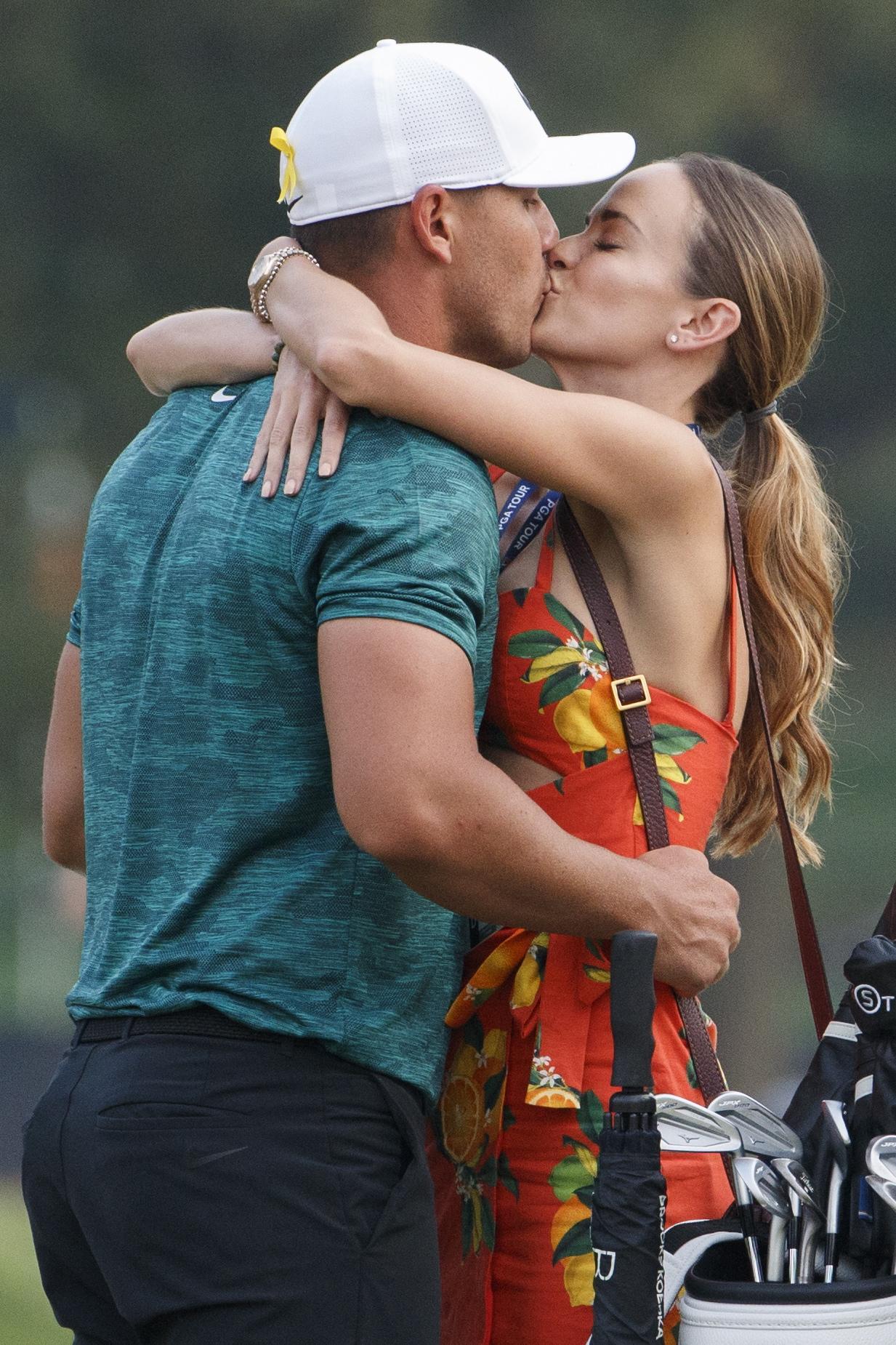 Jena Sims does not hold back as she helps boyfriend Brooks Koepka celebrate