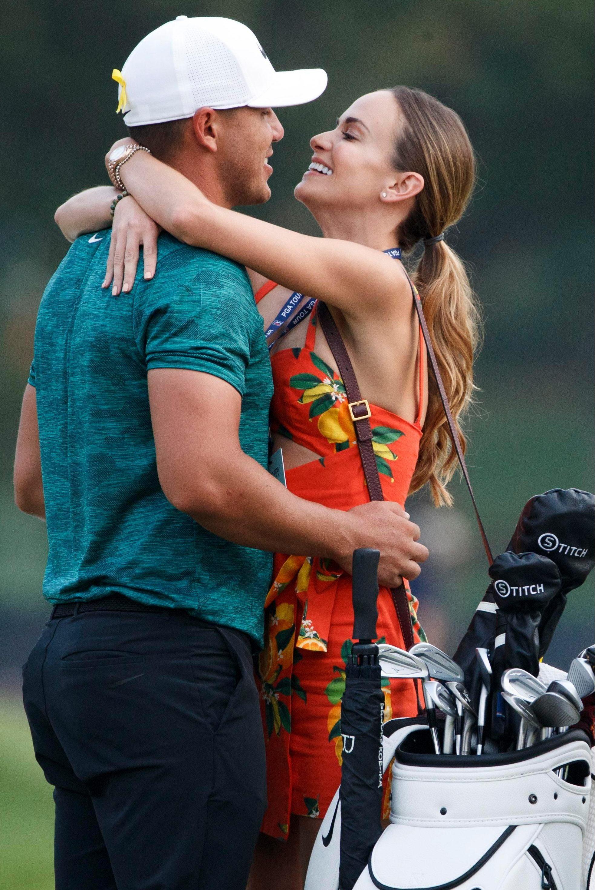 Jena Sims grabs boyfriend Brooks Koepka to congratulate him on his US PGA joy
