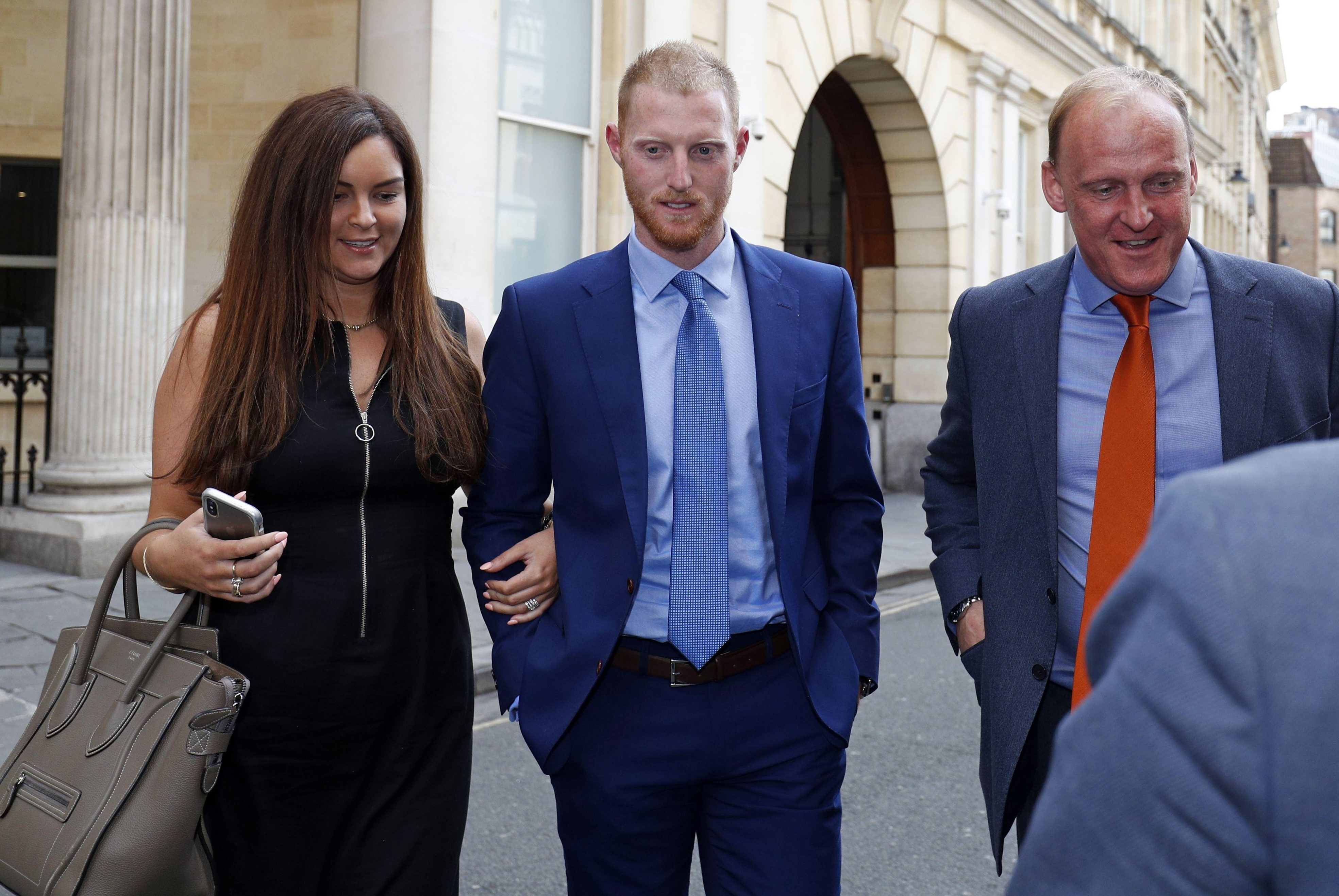 England star Ben Stokes, seen with wife Clare, leaves Bristol Crown Court after his affray case broke for the day