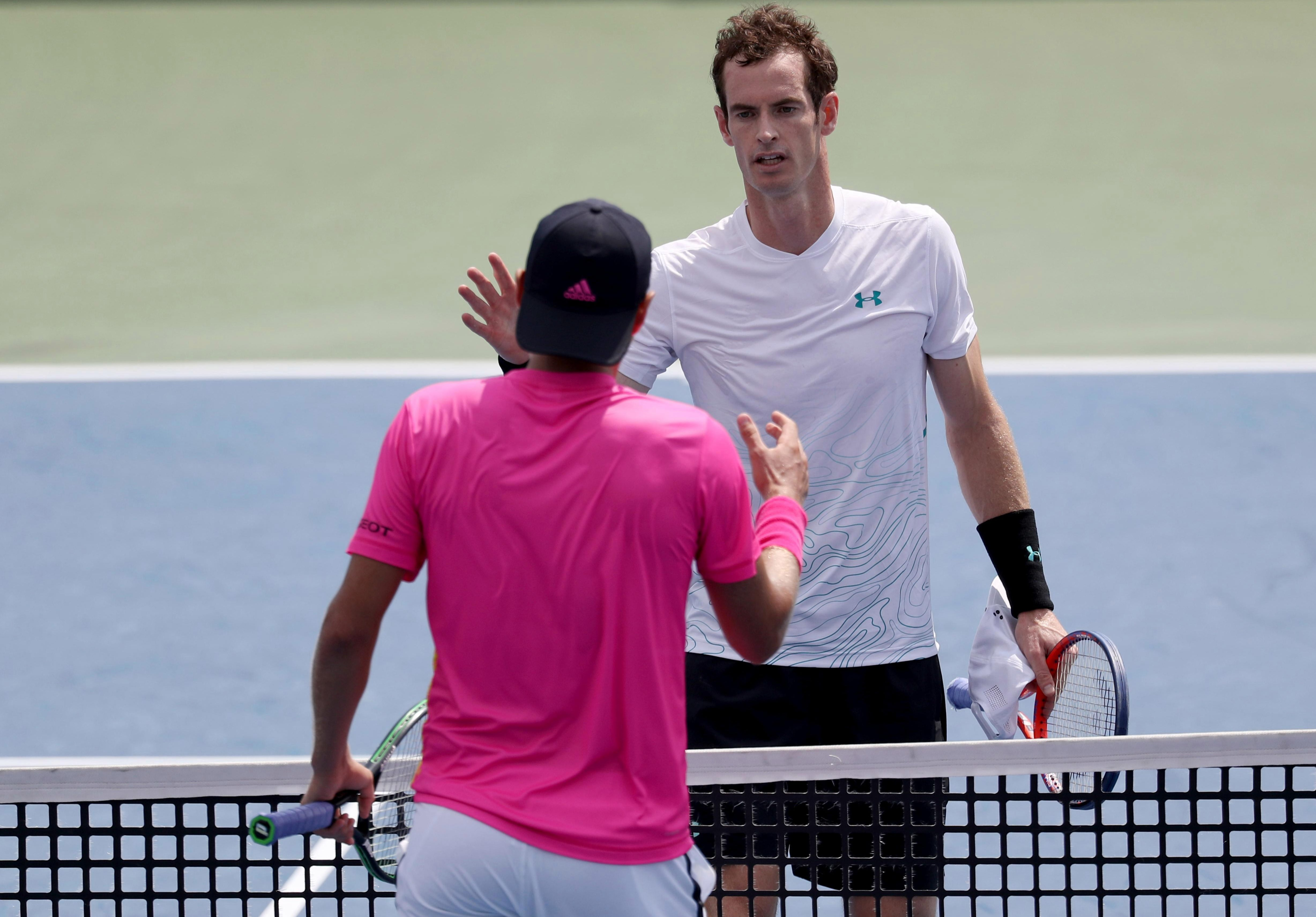 Andy Murray congratulates Lucas Pouille on his three-set victory at the Lindner Family Tennis Centre
