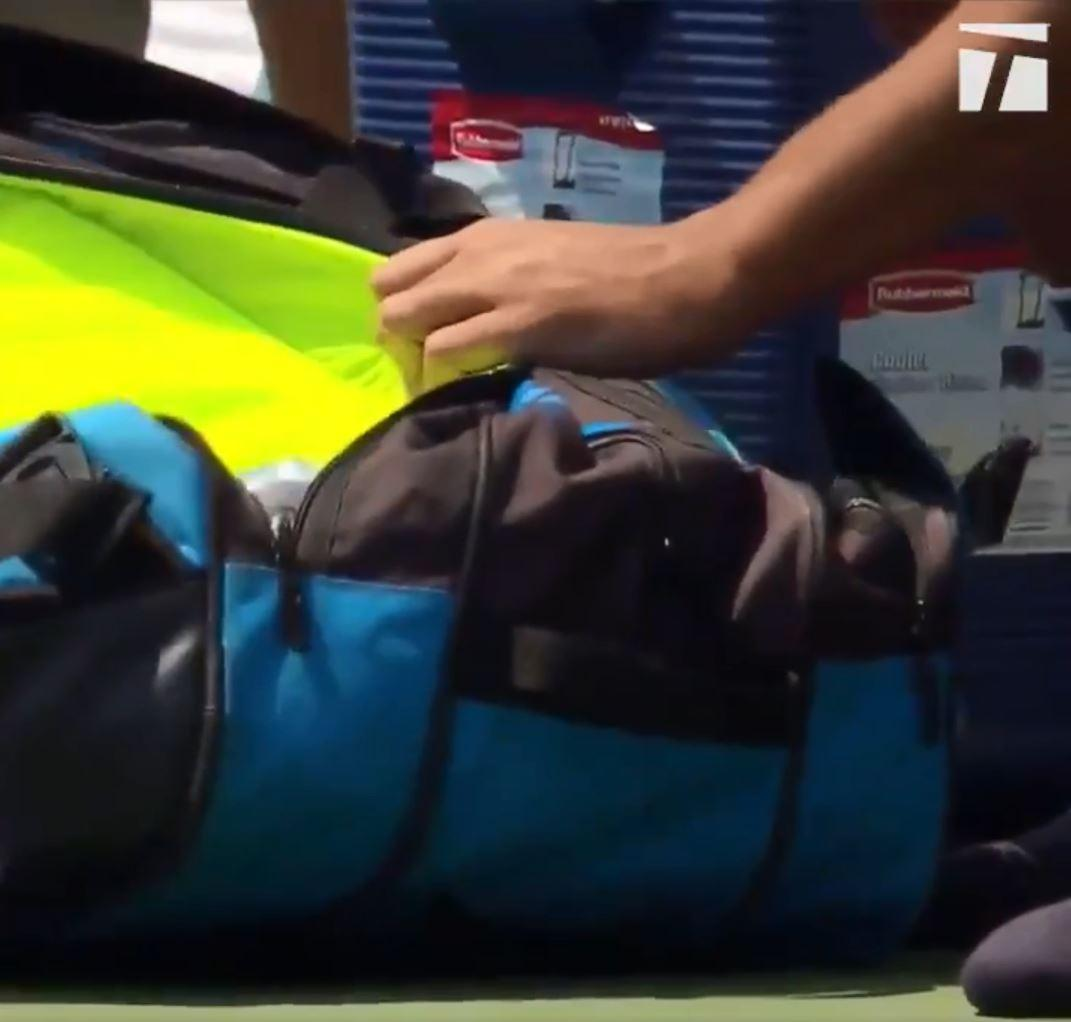 Nick Kyrgios spent ages rummaging through his bag before realising his error