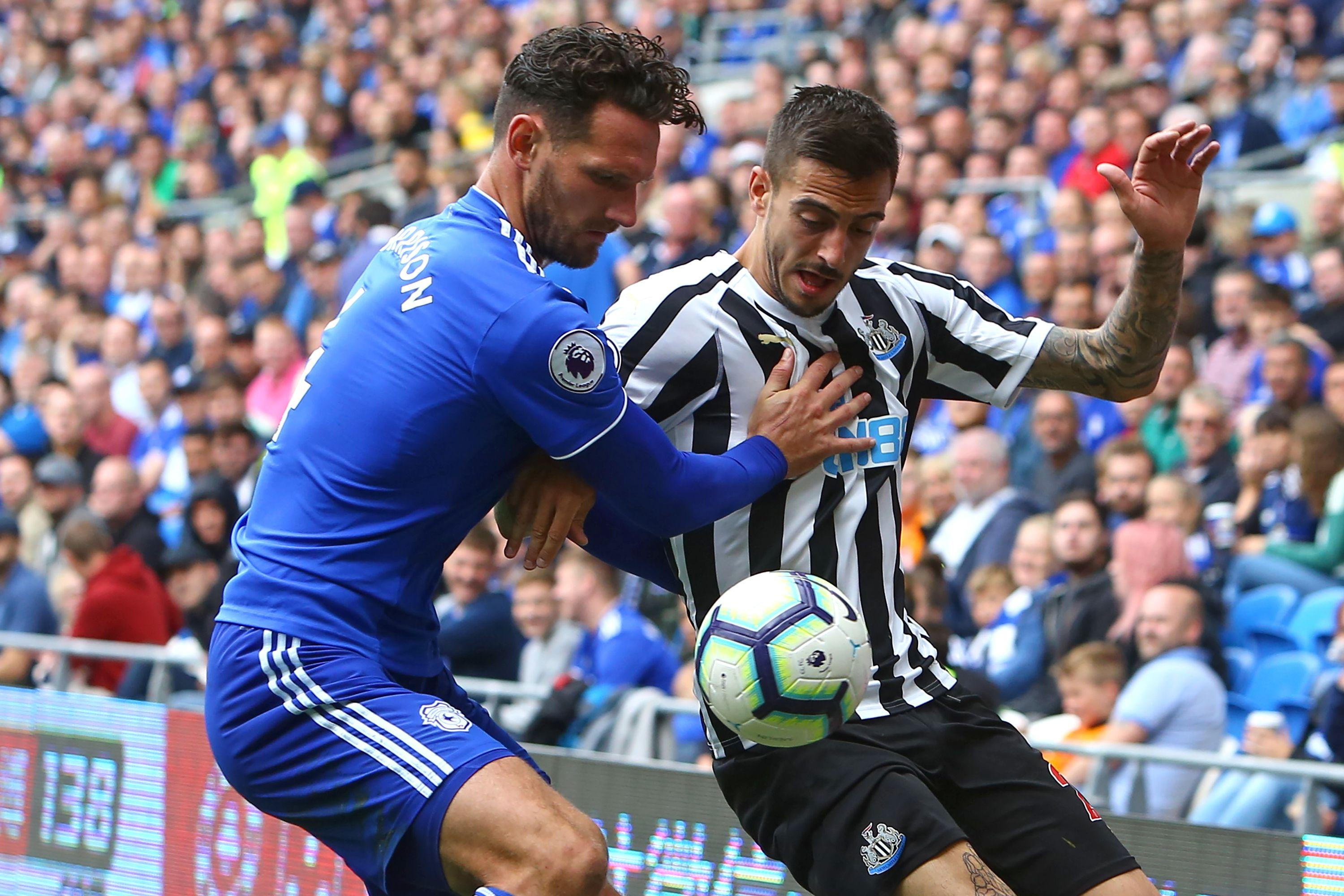 Sean Morrison and Joselu battle for the ball