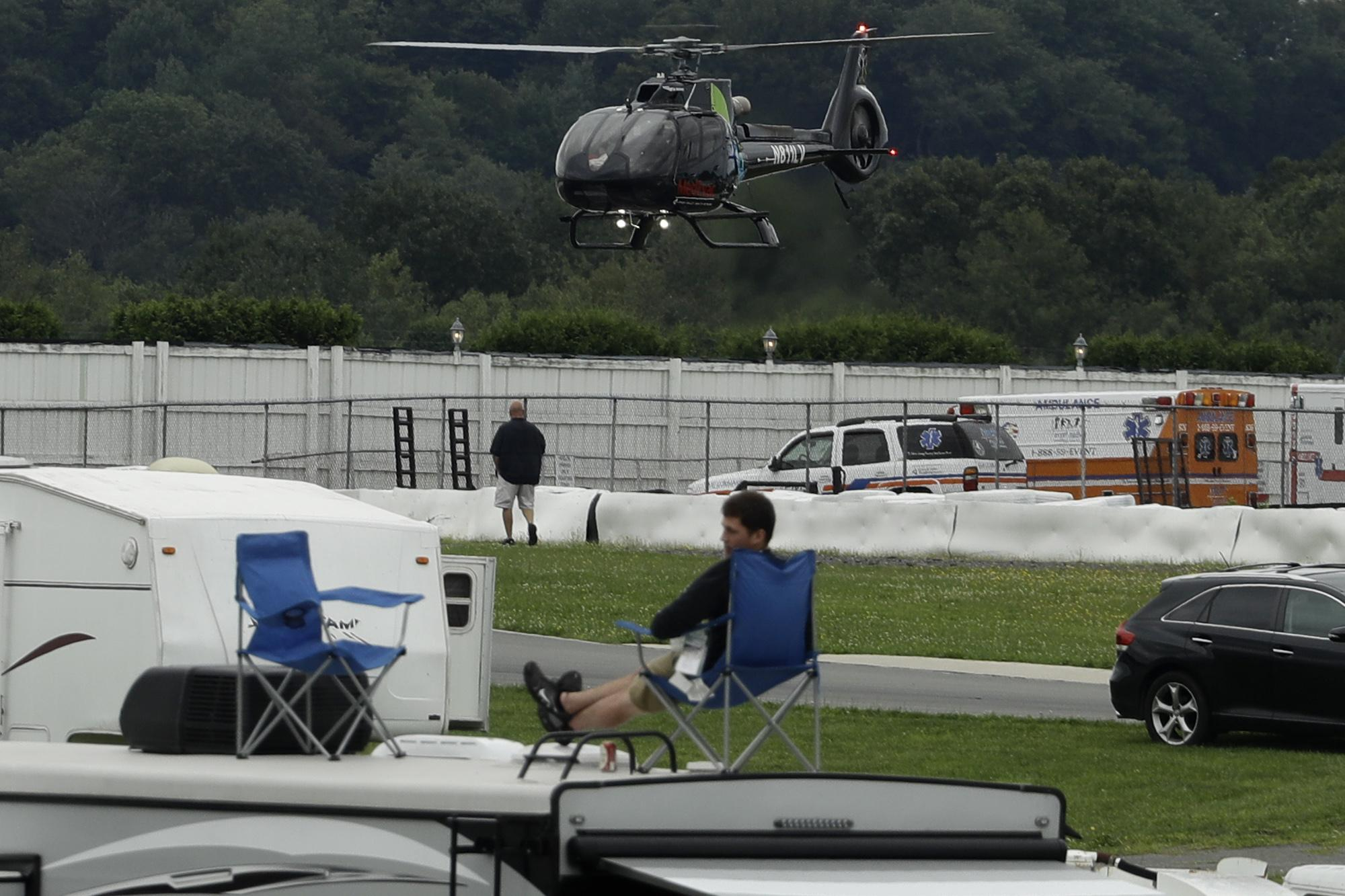 The air ambulance helicopter takes off from the infield during the IndyCar auto race at Pocono Raceway