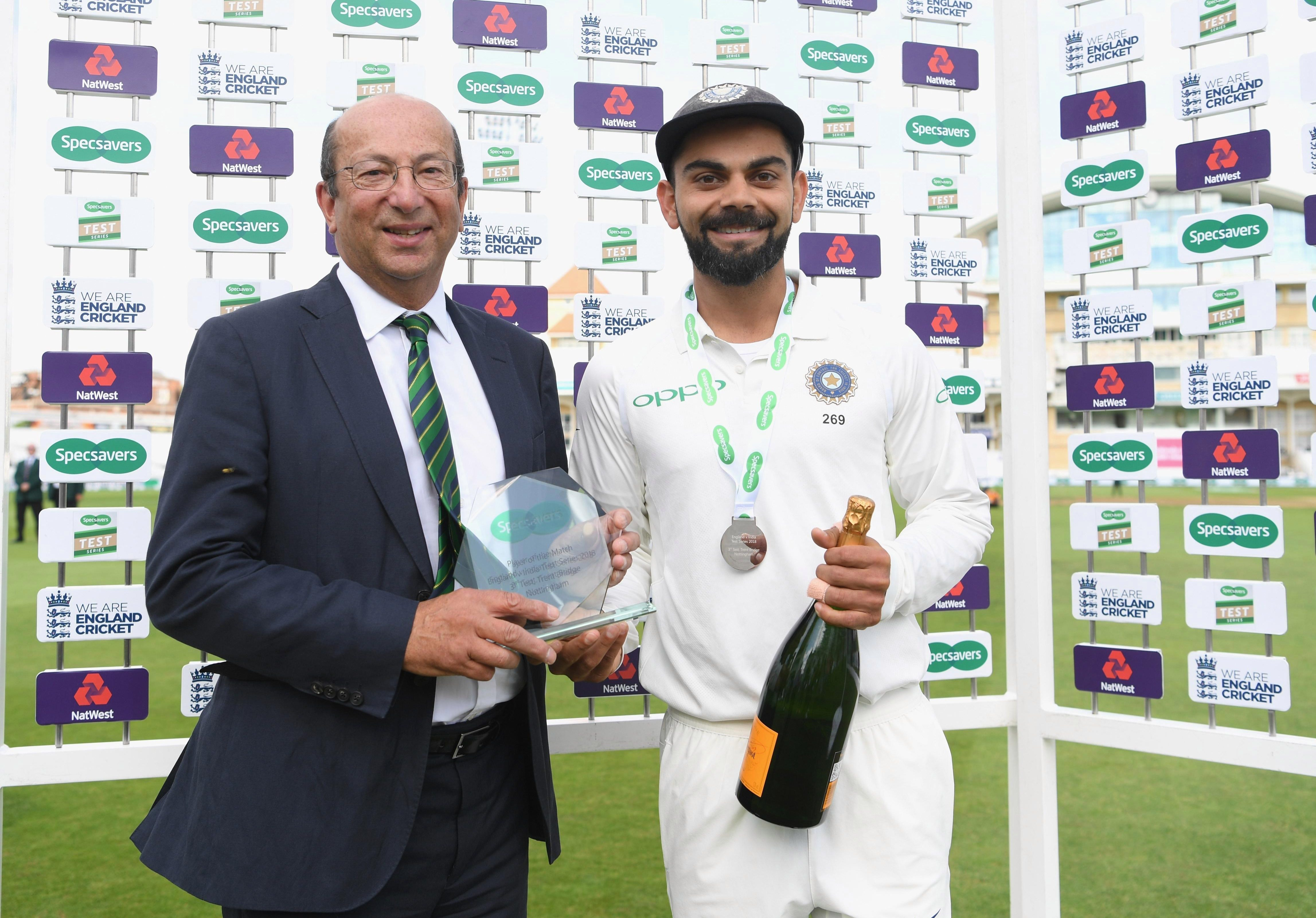 Virat Kohli receives Man of the Match trophy now called Person of the Match