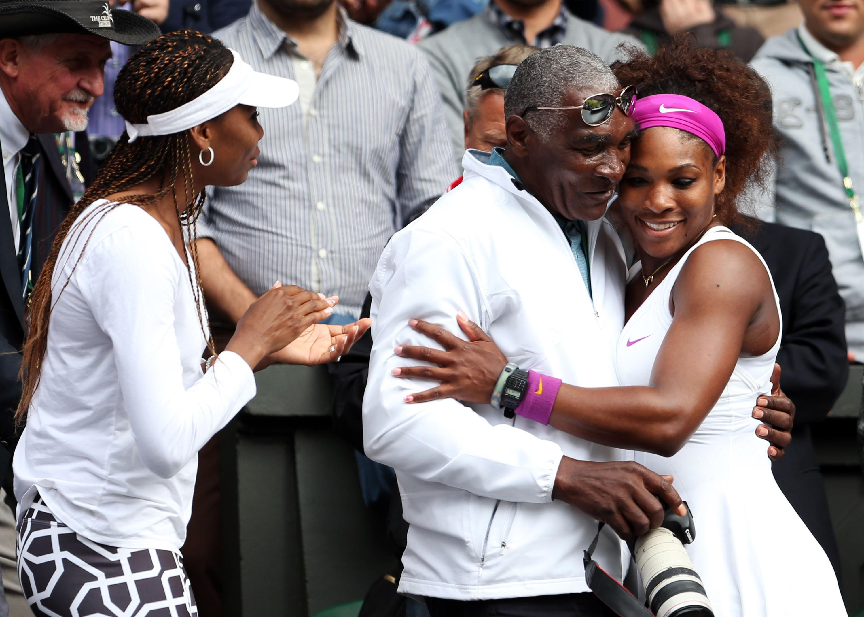 Serena Williams, pictured hugging her father Richard Williams, with sister Venus to the left, is a 23-time Grand Slam winner