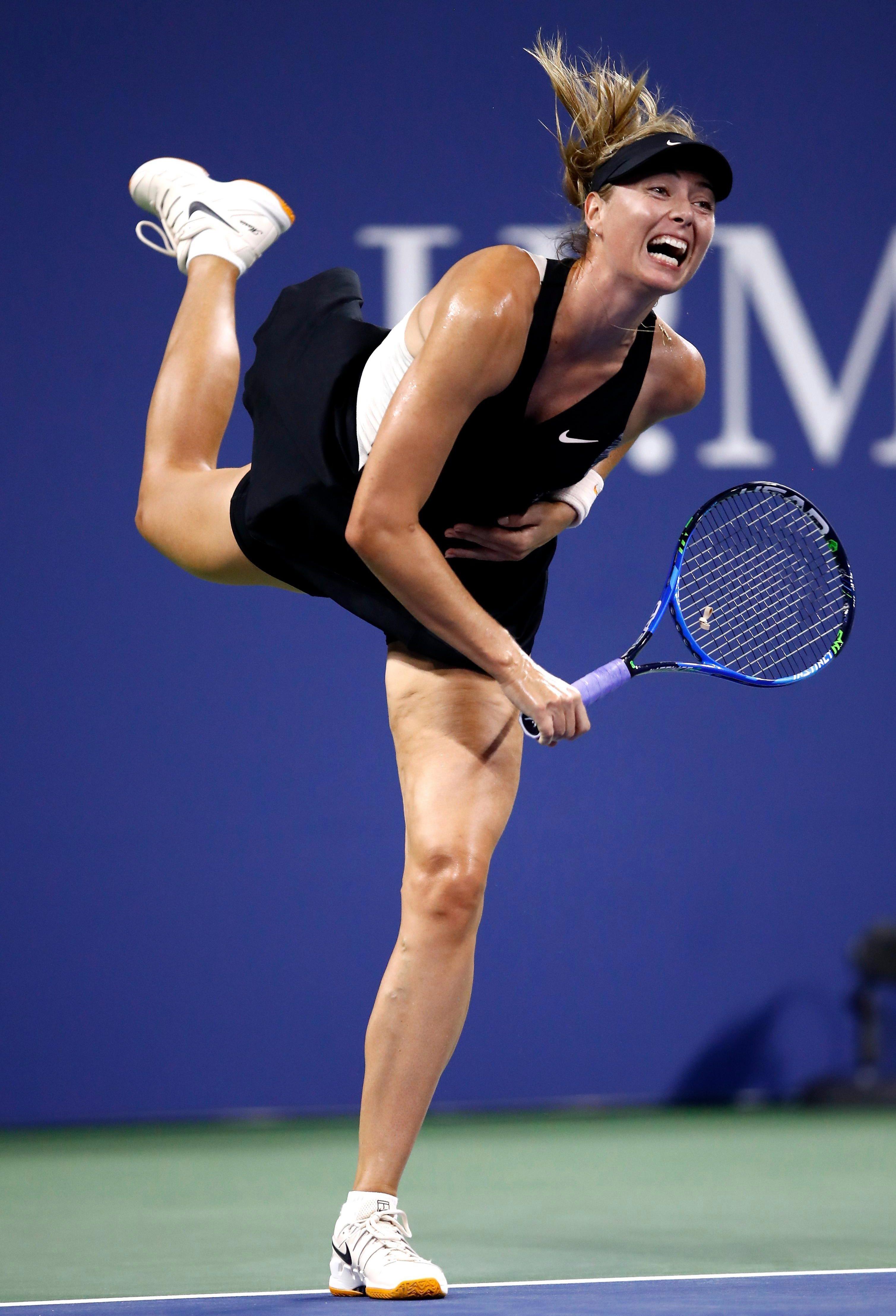 Maria Sharapova fires in a serve in New York