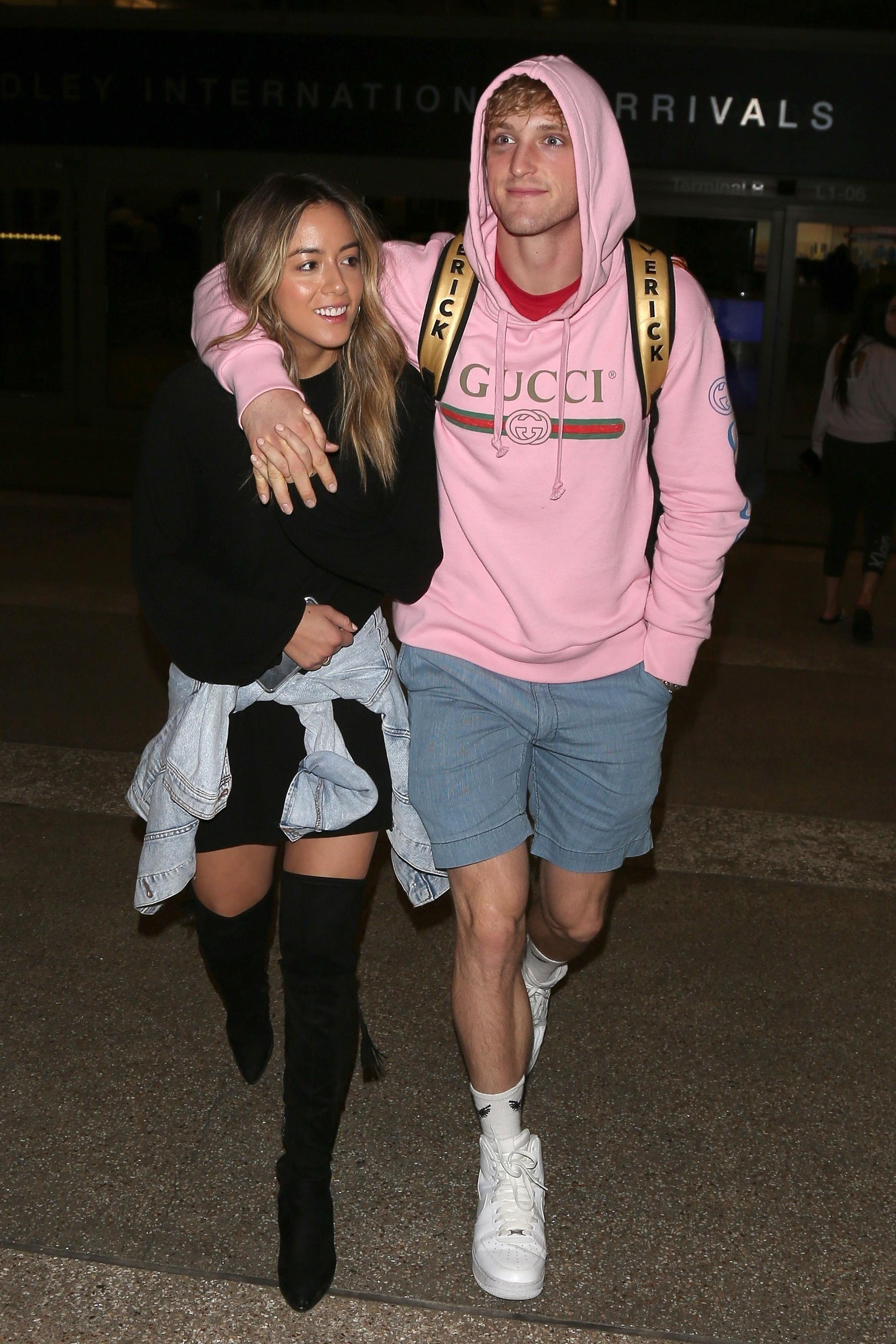 Logan Paul and actress girlfriend Chloe Bennet strolled out of LAX after the £150m bout at Manchester Arena