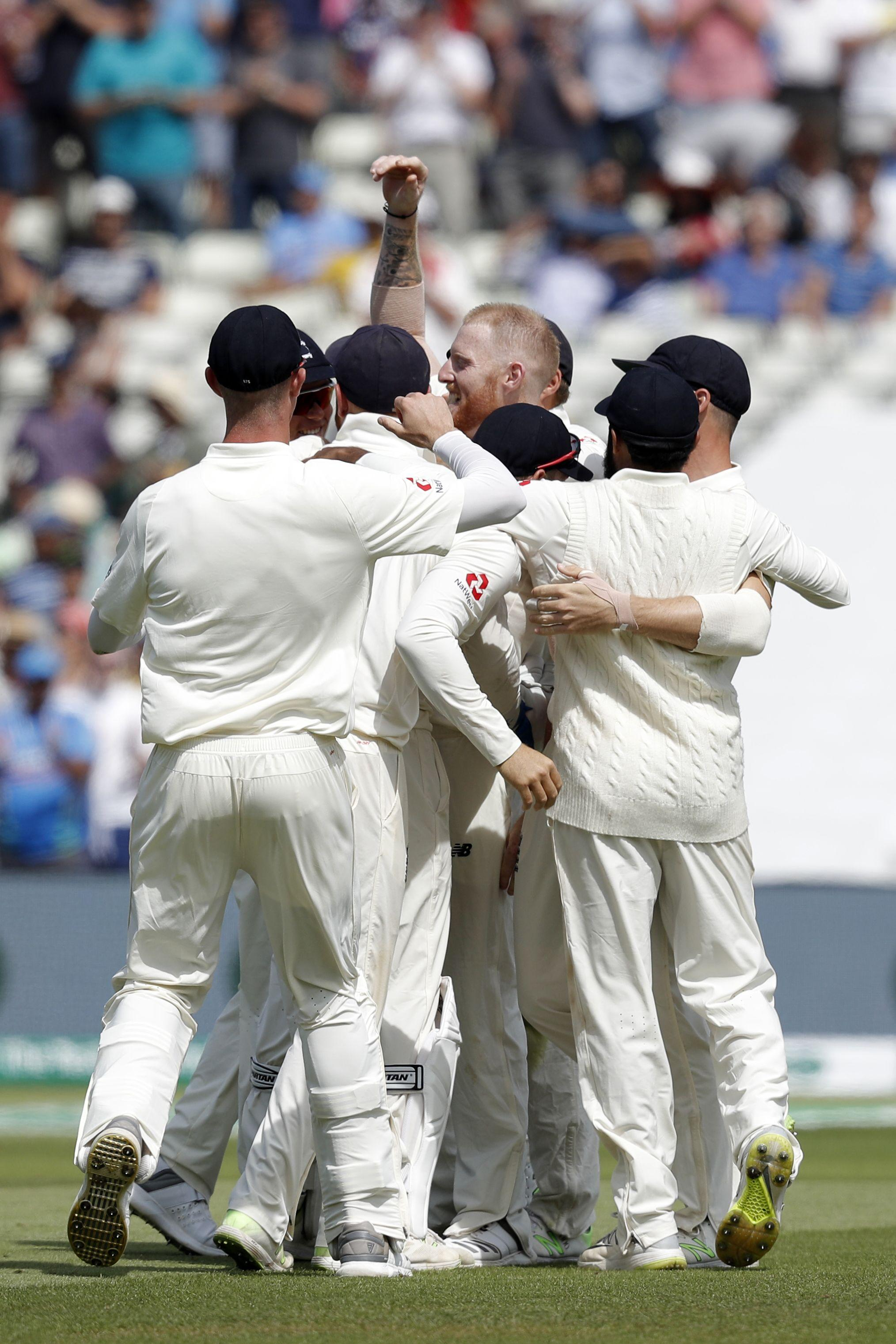 England celebrate victory in their 1,000th Test match