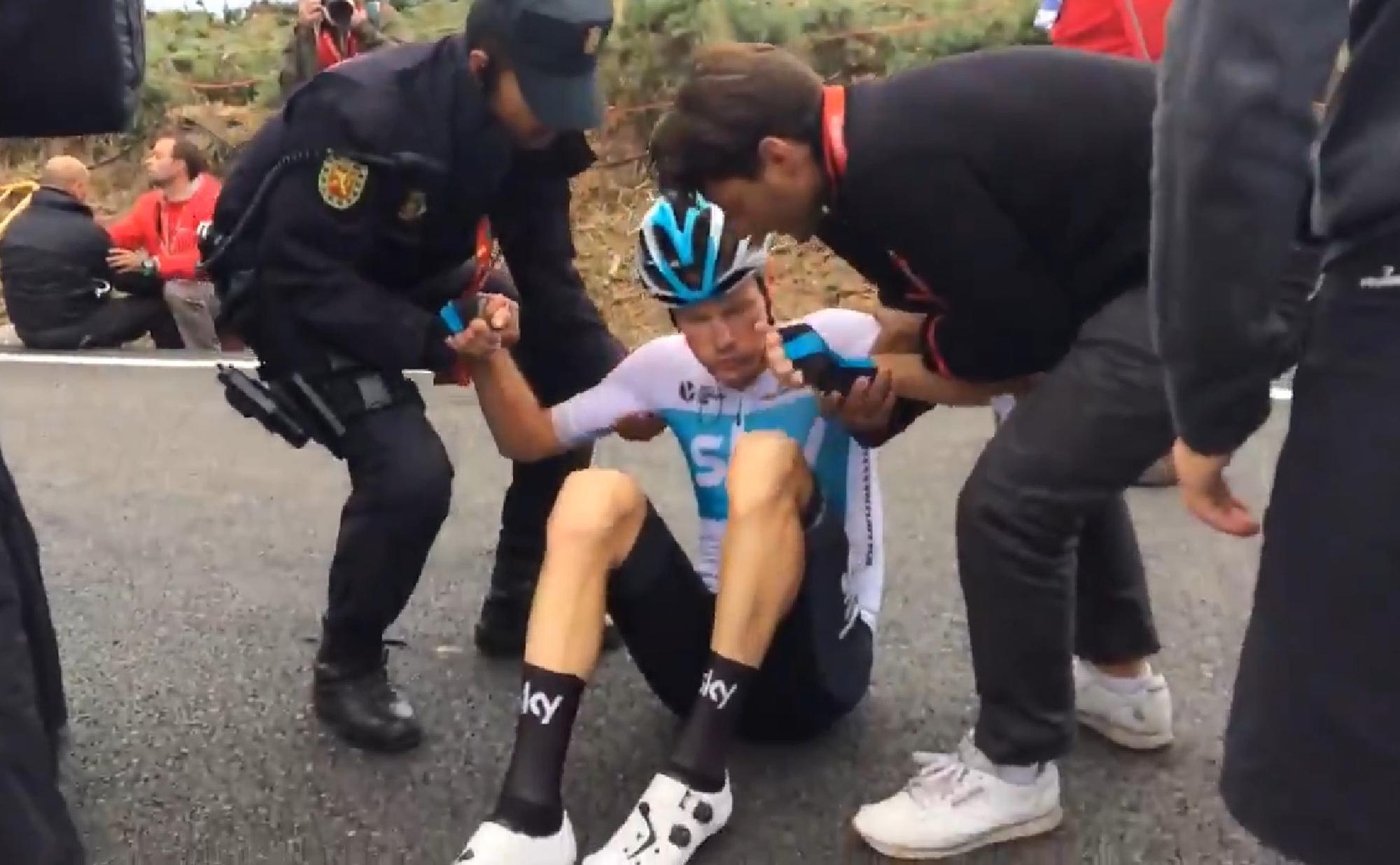Dutchmen van Baarle reacts after colliding into the bungling race official