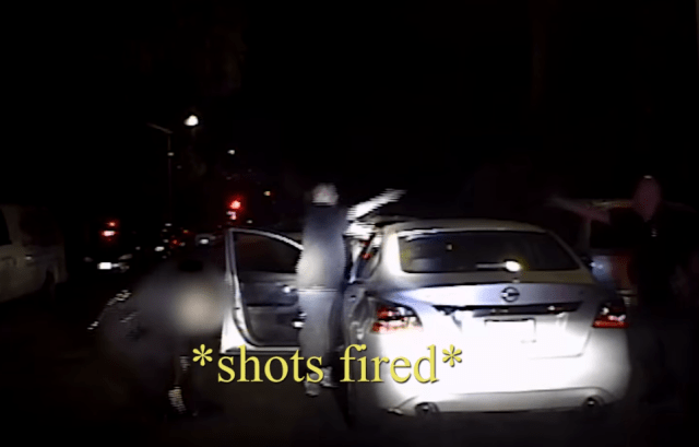 This is the moment the suspect turned his gun on the female cop's partner after shooting her