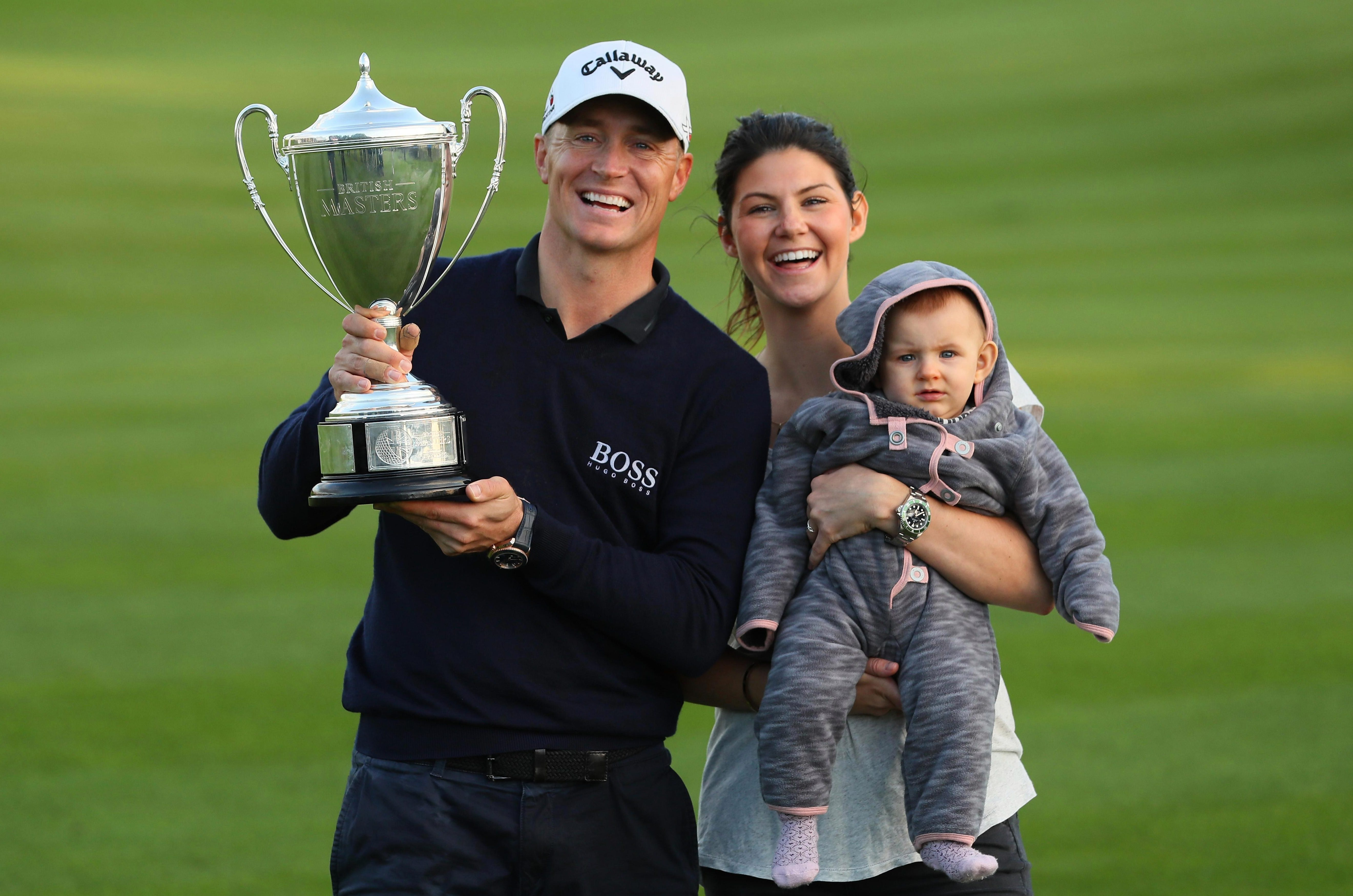 Alex Noren and Jennifer Kovacs celebrate with the trophy at the British Masters in 2016