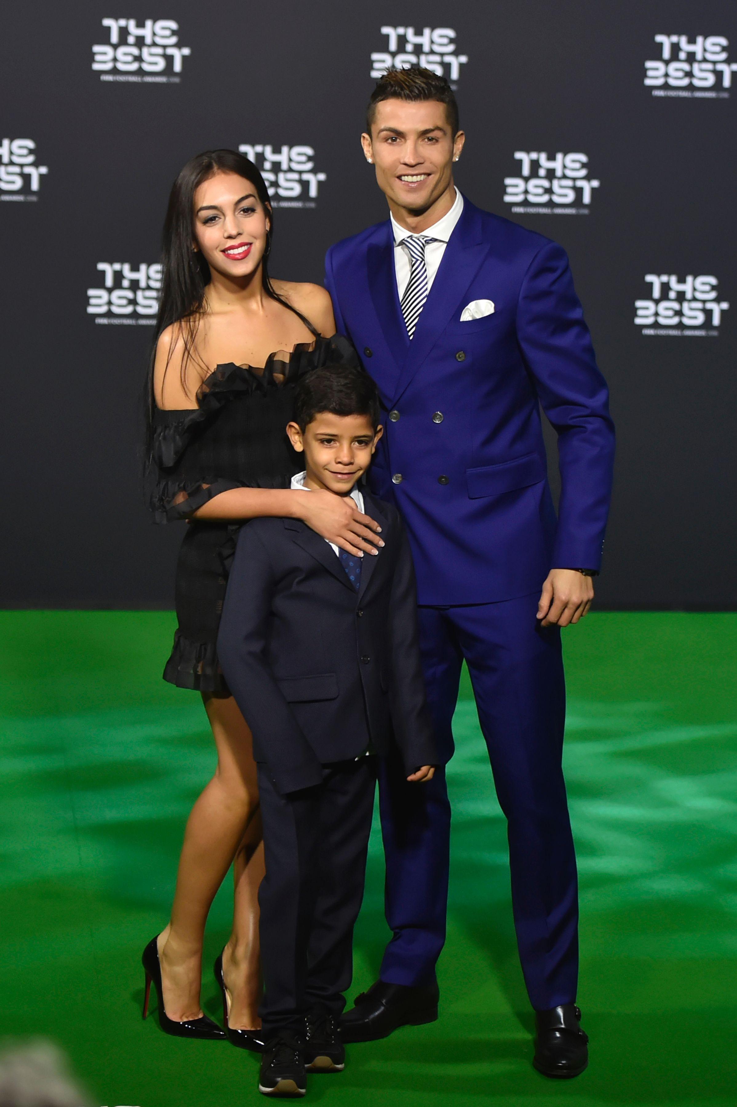 Cristiano Ronaldo posing with his partner Georgina Rodriguez and his son Cristiano Ronaldo J