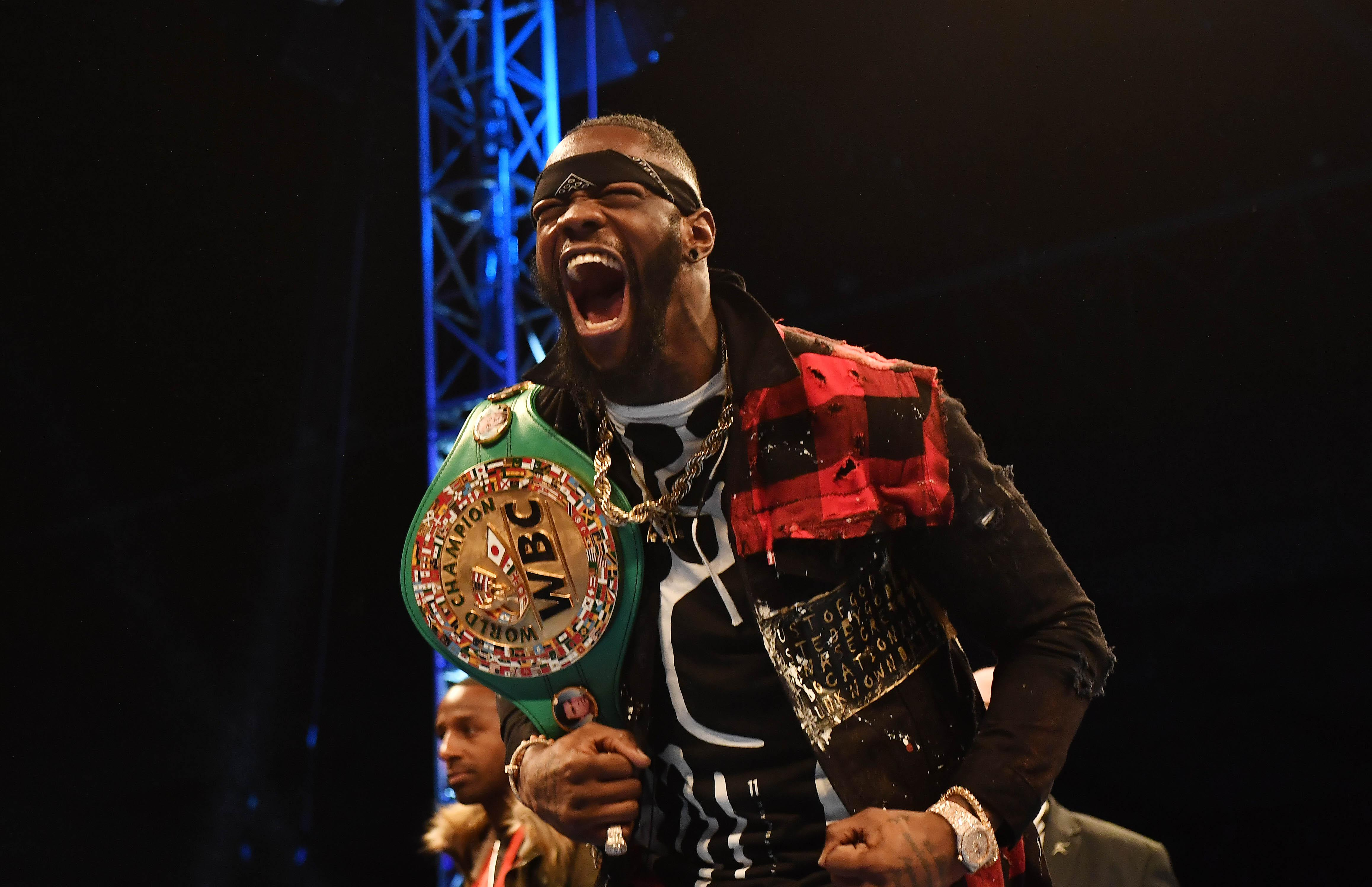 Deontay Wilder holds the illusive WBC title belt