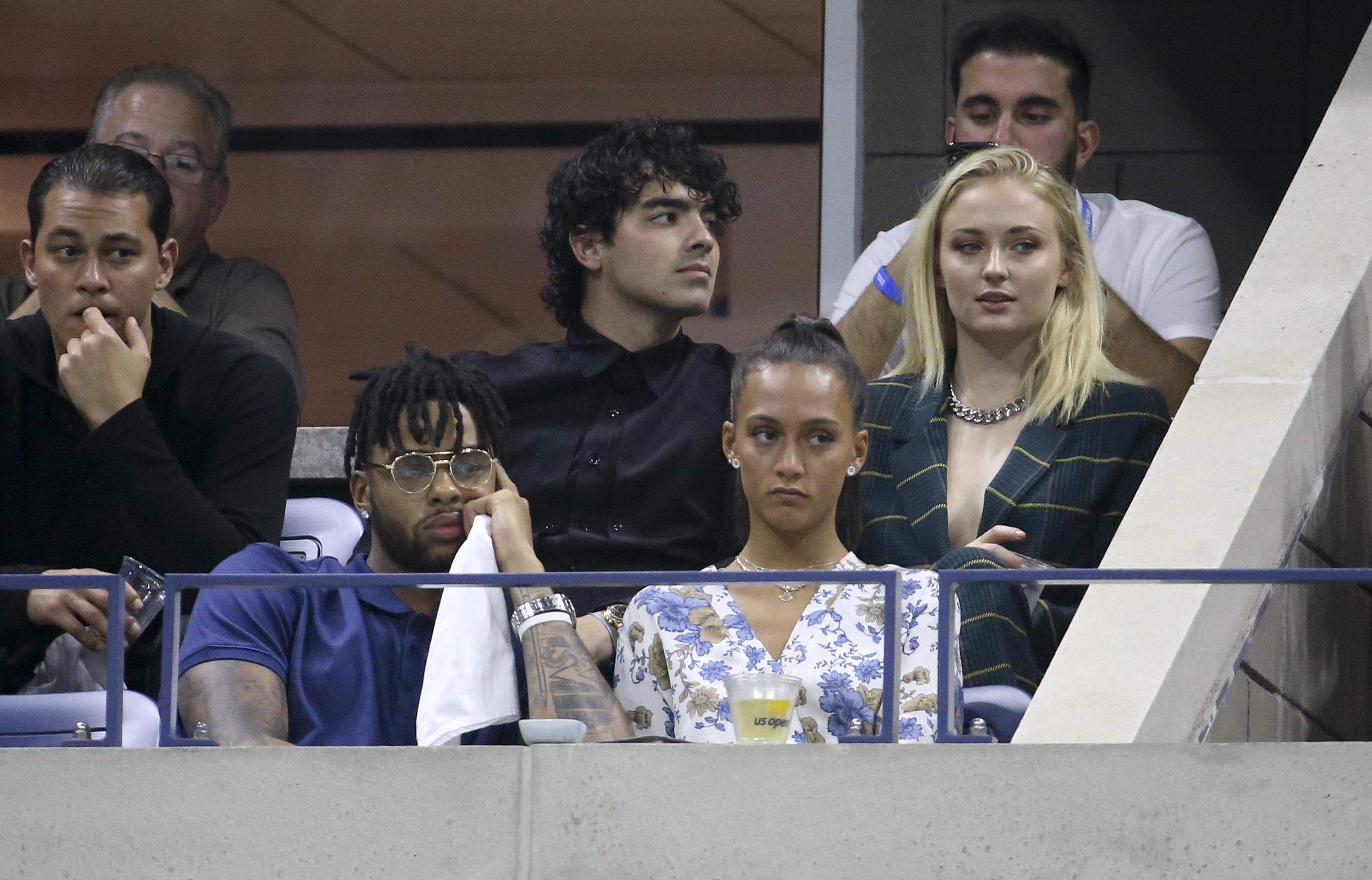 Pop star Joe Jonas, middle, and Game of Thrones girlfriend Sophie Turner were in the crowd - NBA star D'Angelo Russell sat in front of them