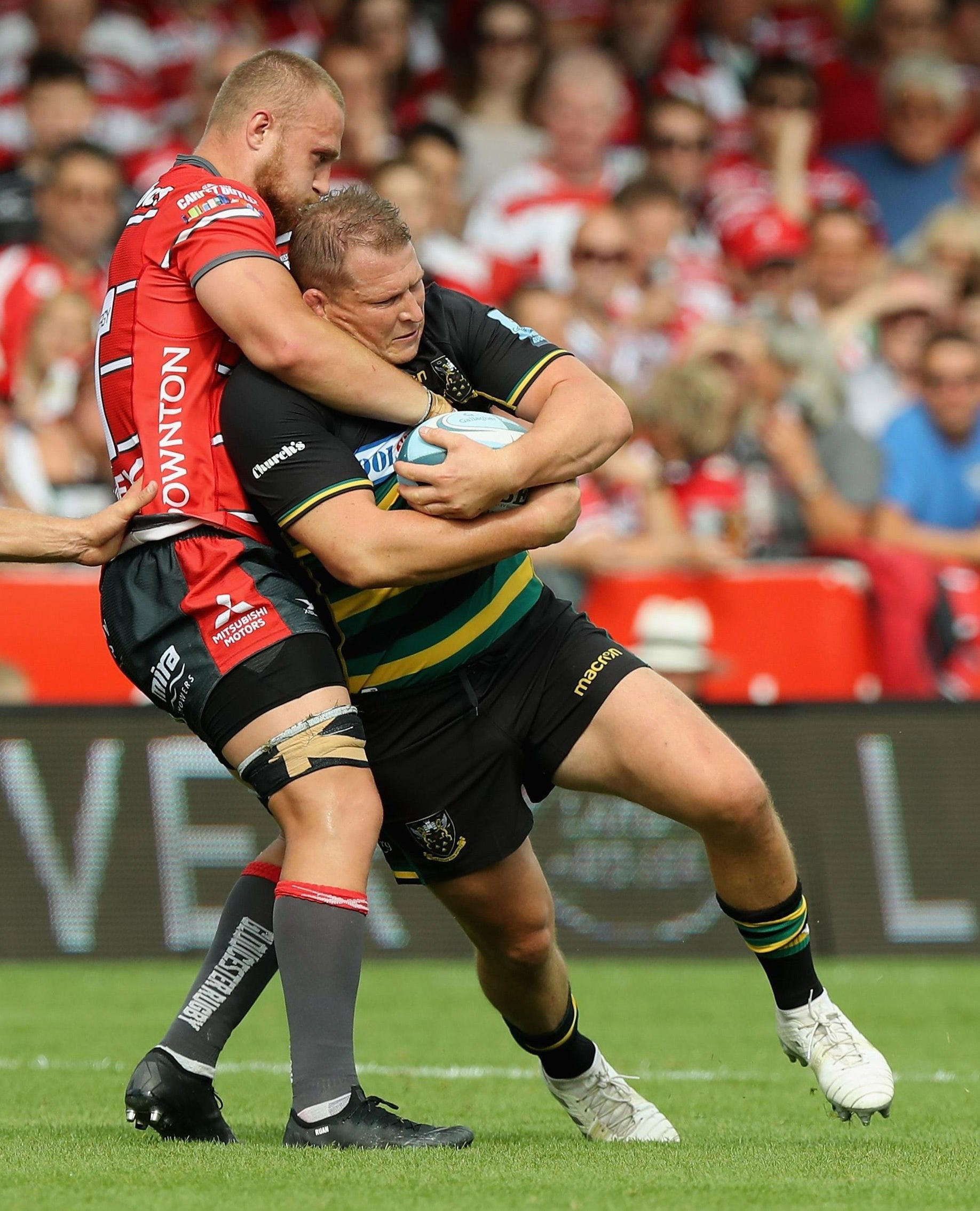 Northampton star Dylan Hartley is tackled on his comeback by Ruan Ackermann