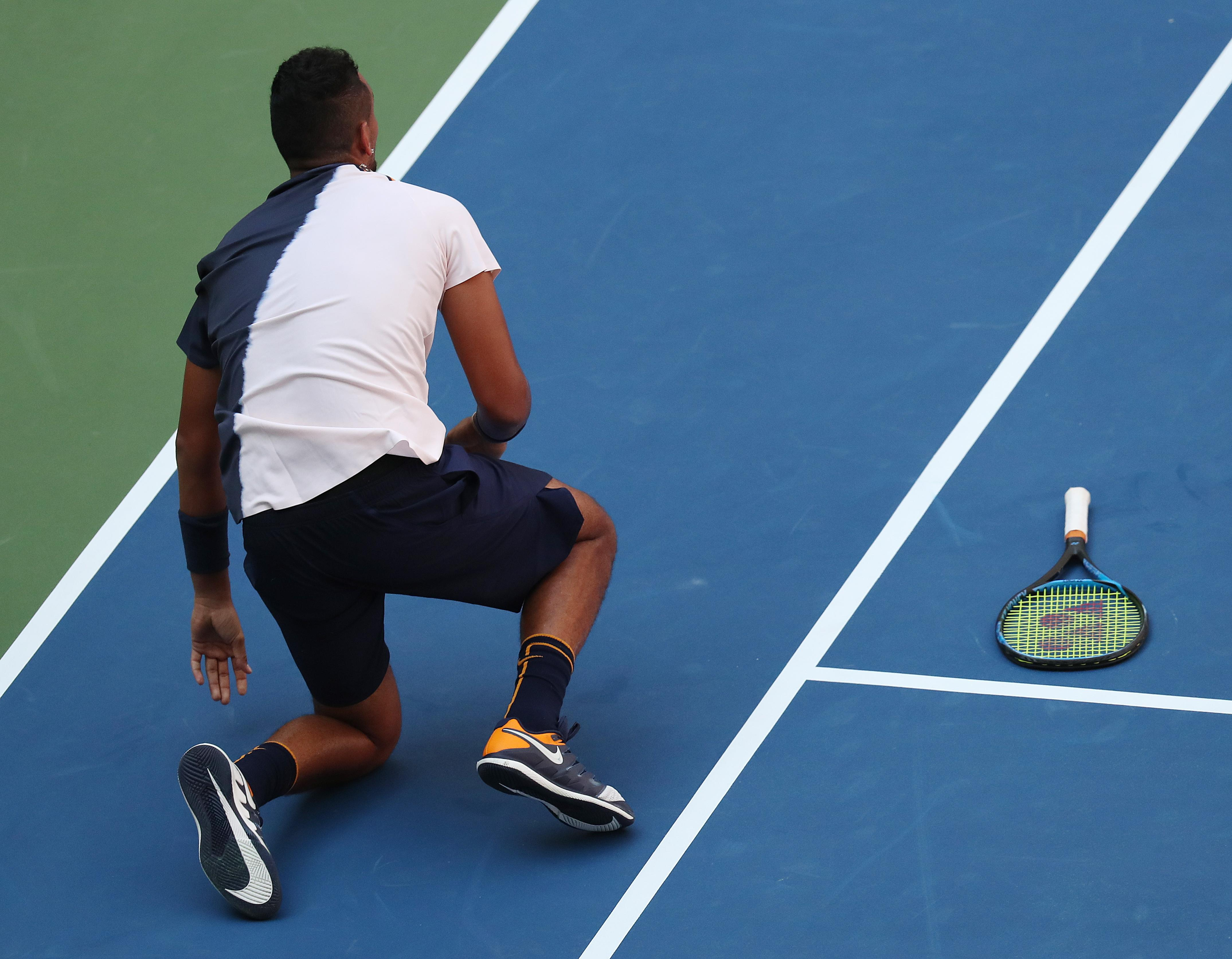Kyrgios and his racket are left on the court as Federer showed no mercy to the Aussie