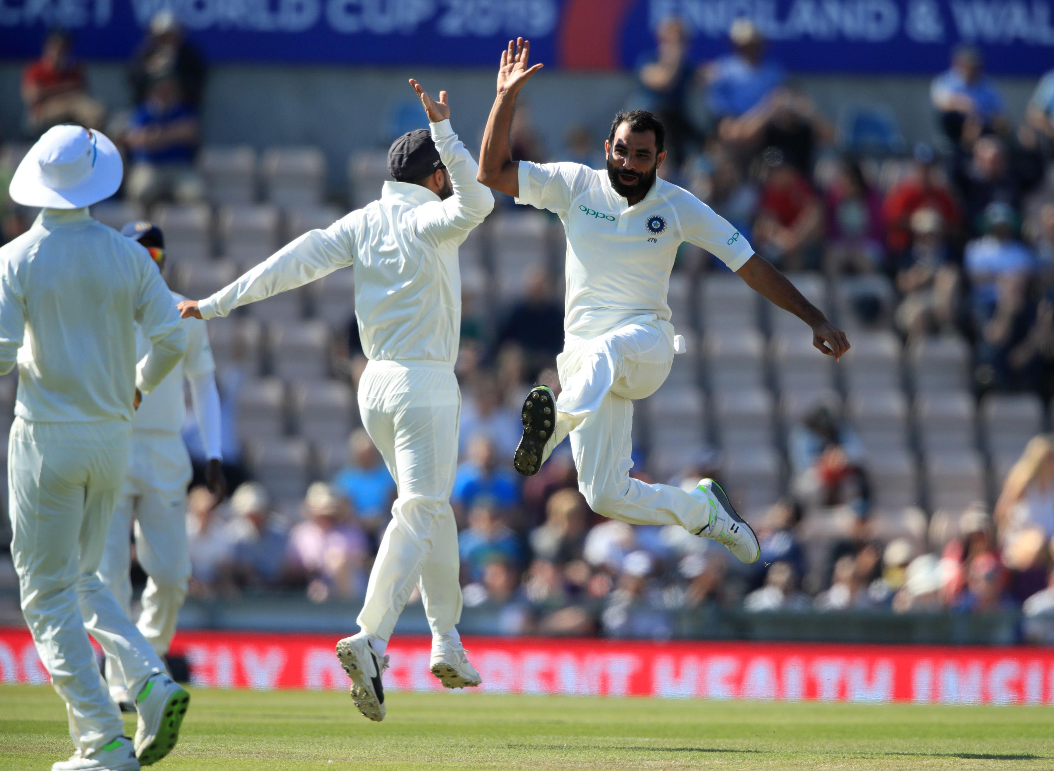 India celebrated their superb start after the wicket of Stuart Broad
