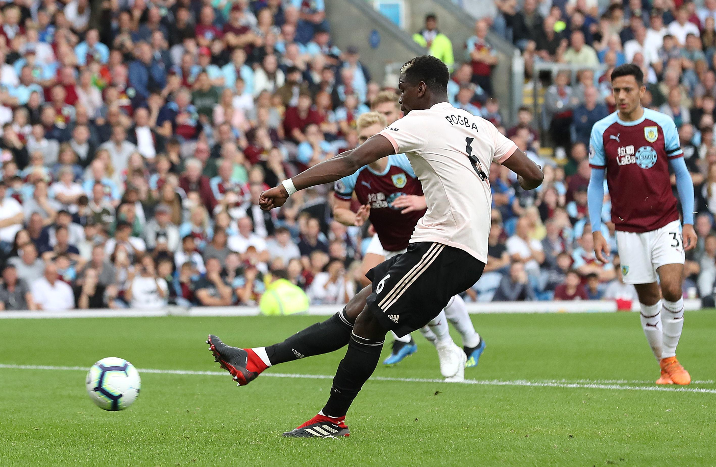 Paul Pogba strides forward before seeing his penalty saved by Joe Hart