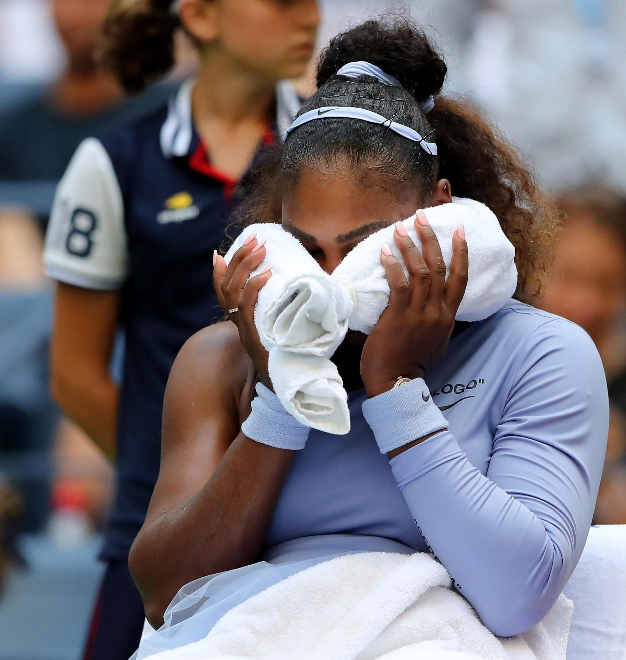 The American cools herself down at a changeover as the New York heat takes its toll