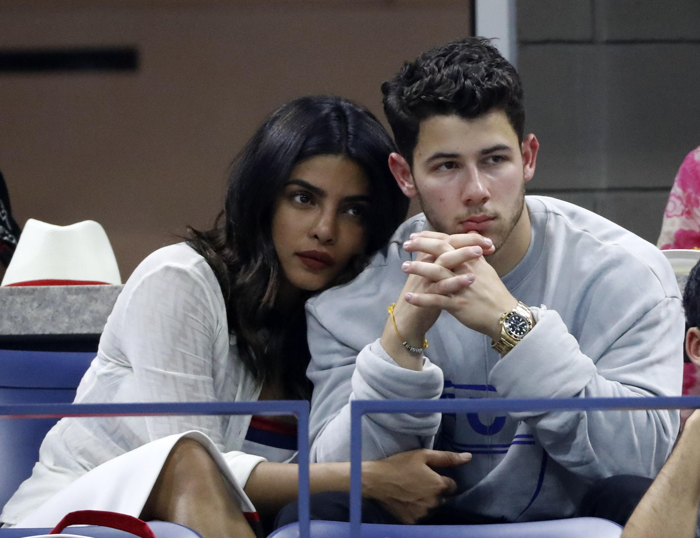 Indian actress Priyanka Chopra and her partner Nick Jonas watch the action unfold