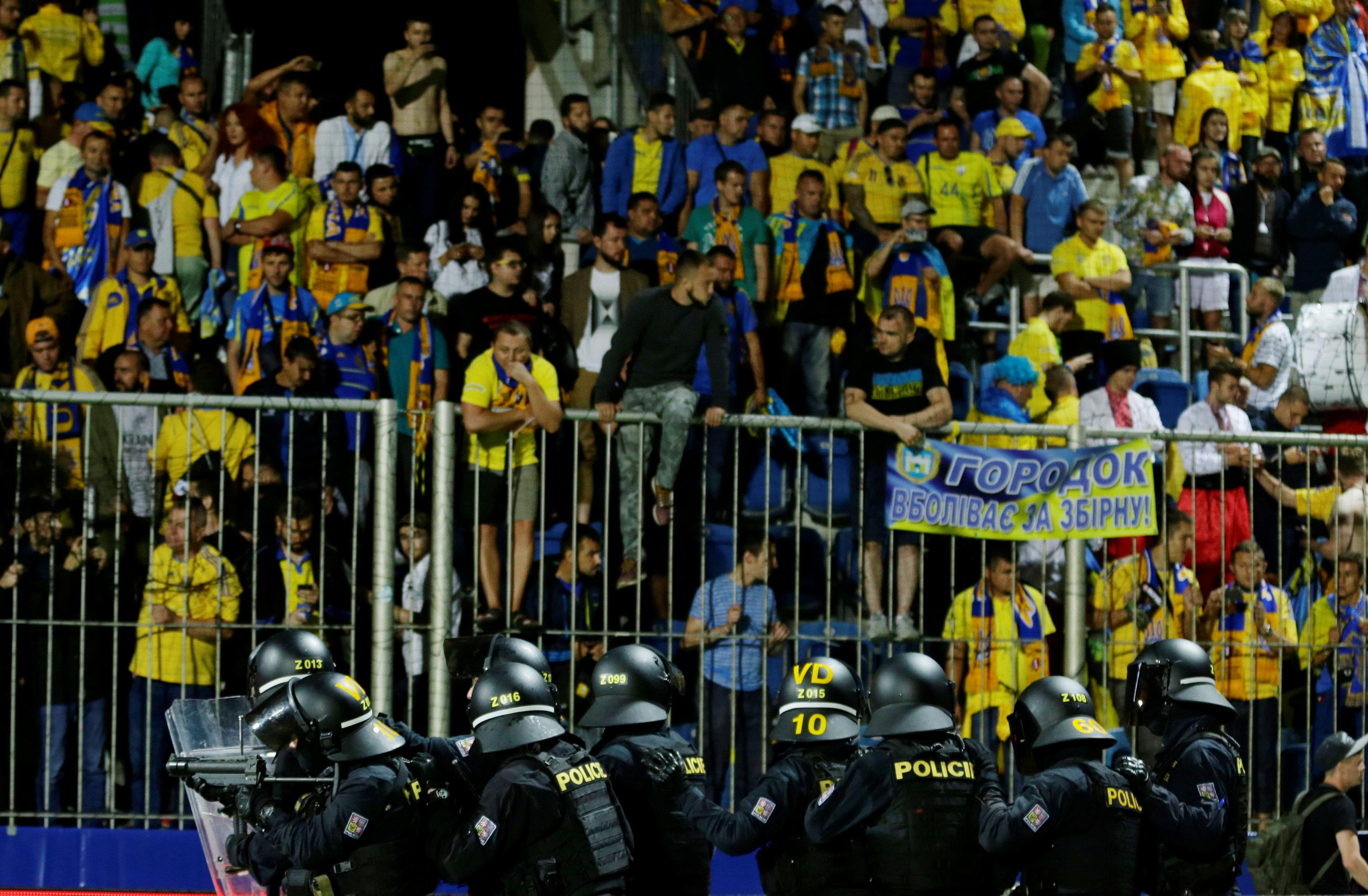 Riot police were forced to intervene after crowd trouble following the game