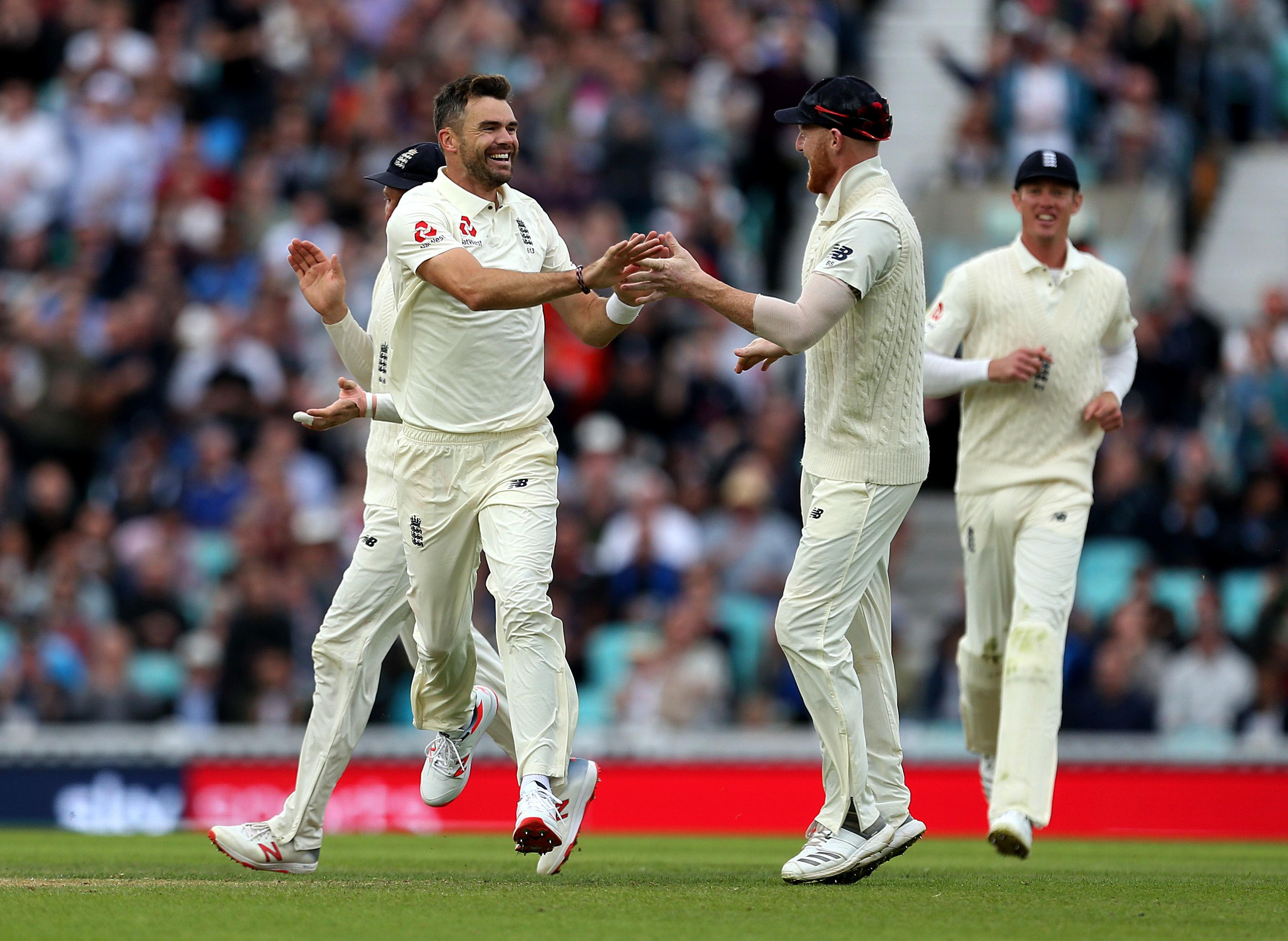 James Anderson celebrates the wicket of India's Ajinkya Rahane after caught by Alastair Cook.