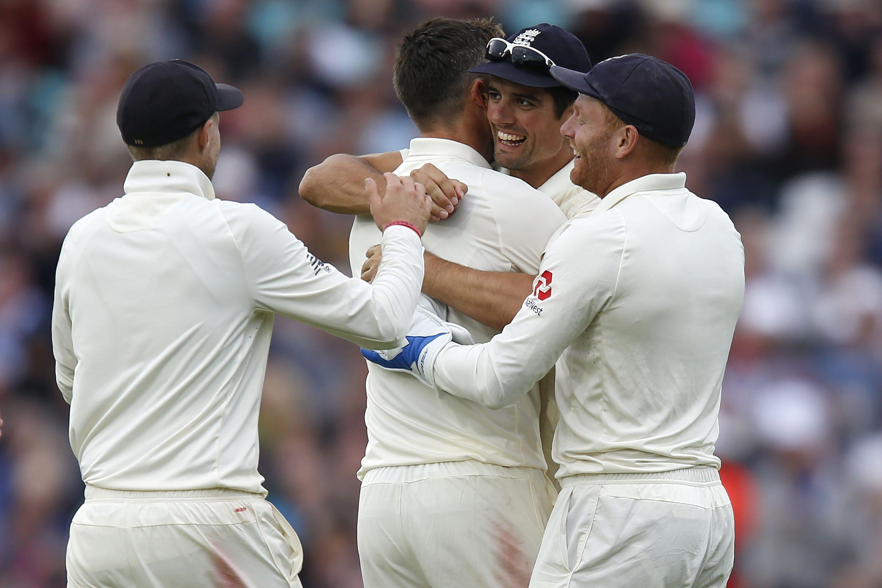 James Anderson celebrates with Joe Root, Alastair Cook and Jonny Bairstow after taking the wicket of India's Ajinkya Rahane.