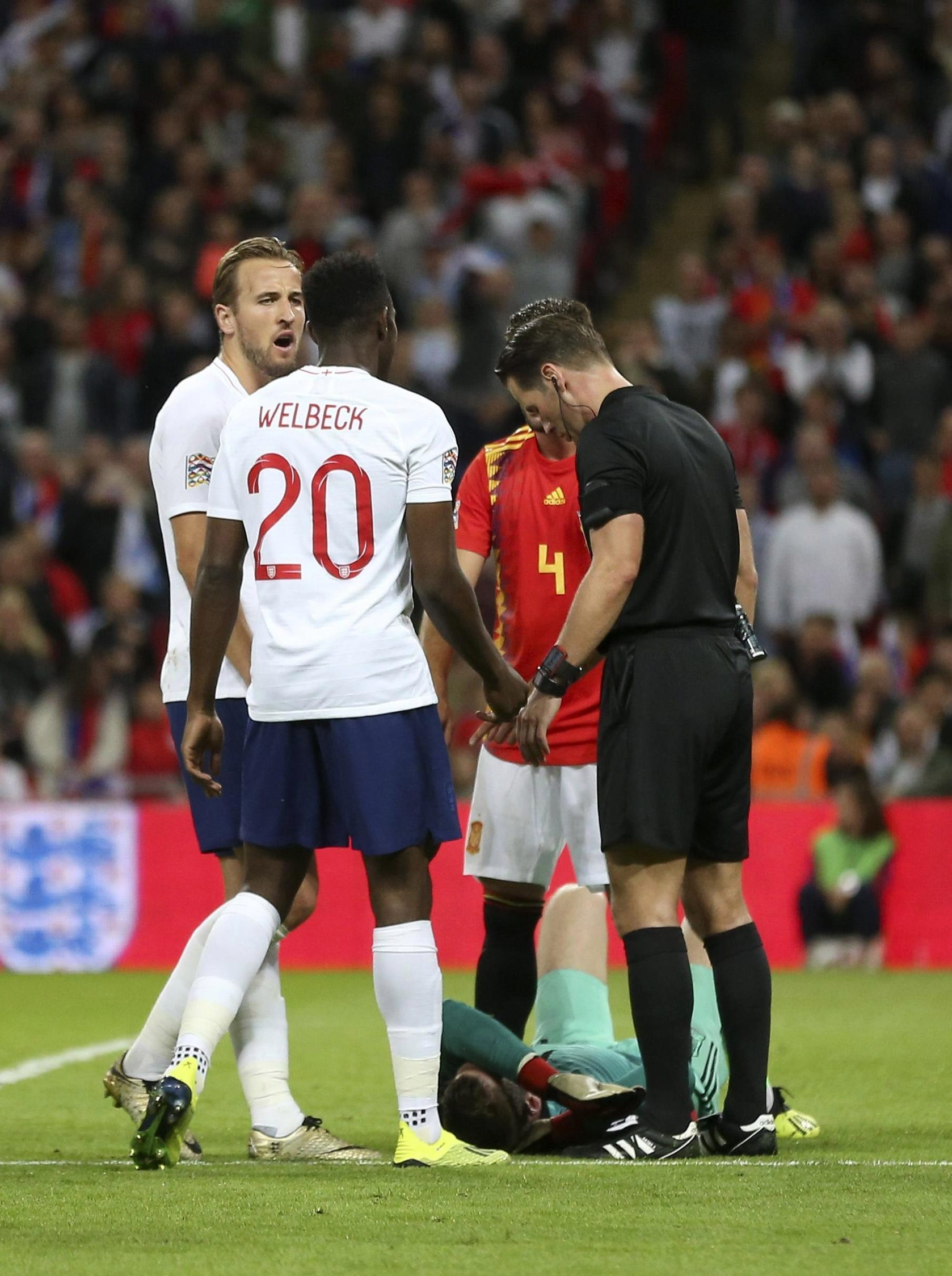 Welbeck protested his innocence but the referee felt De Gea was impeded