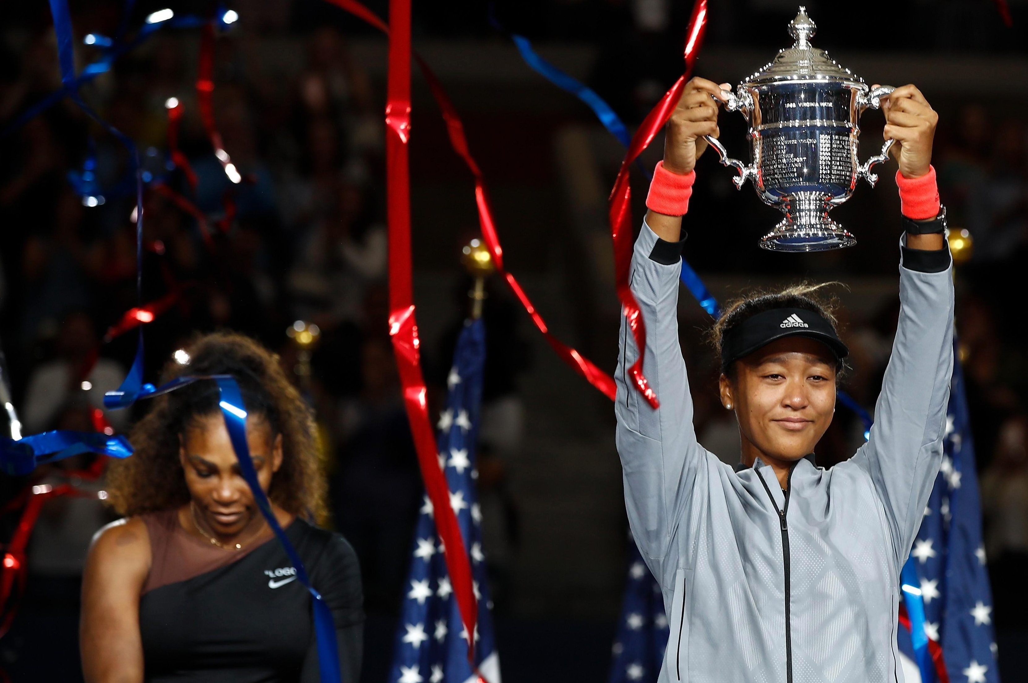 Naomi Osaka celebrates her US Open win in front of a dejected Serena Williams