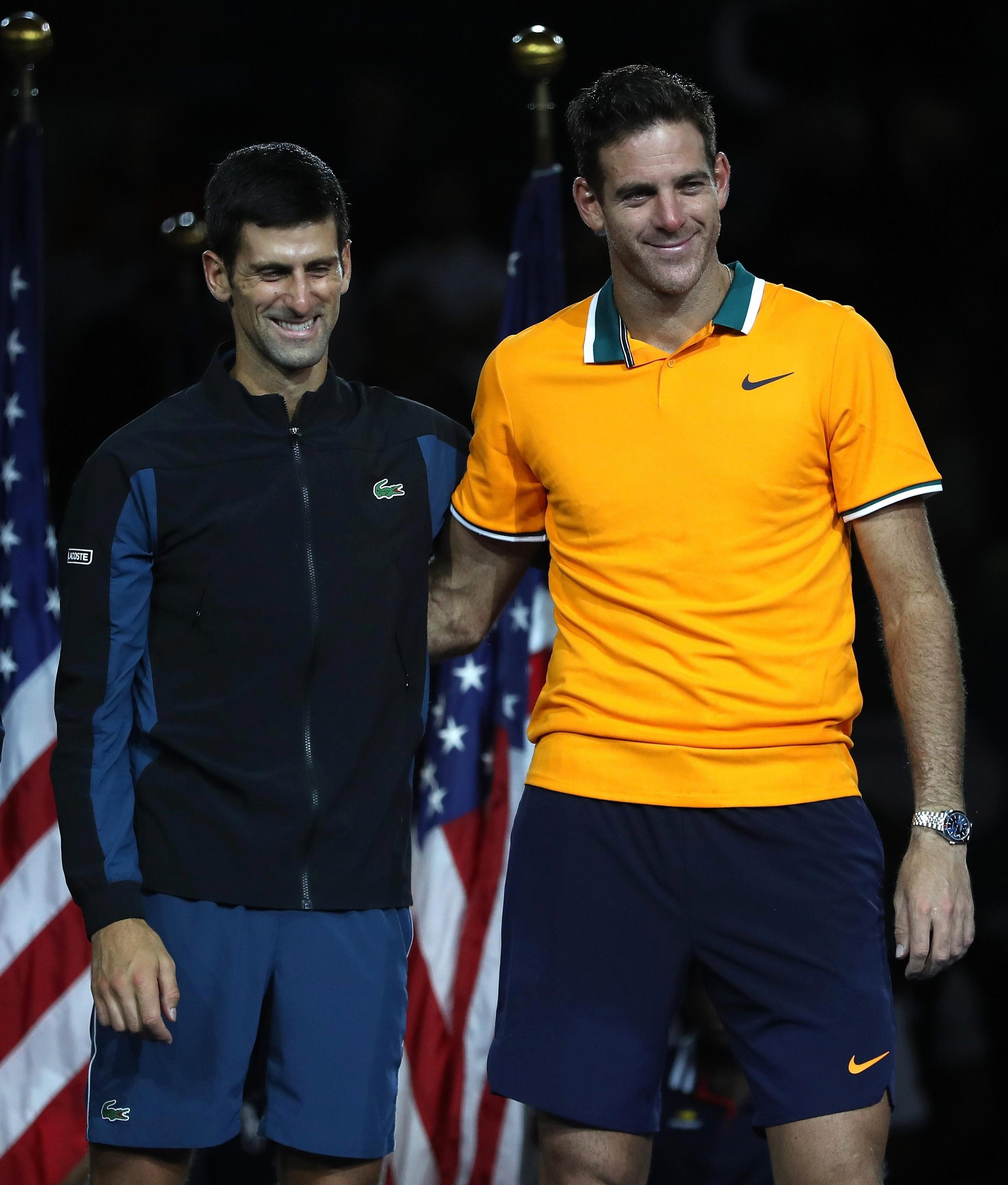 Novak Djokovic and Juan Martin del Potro are able to smile together after hours battling on the court