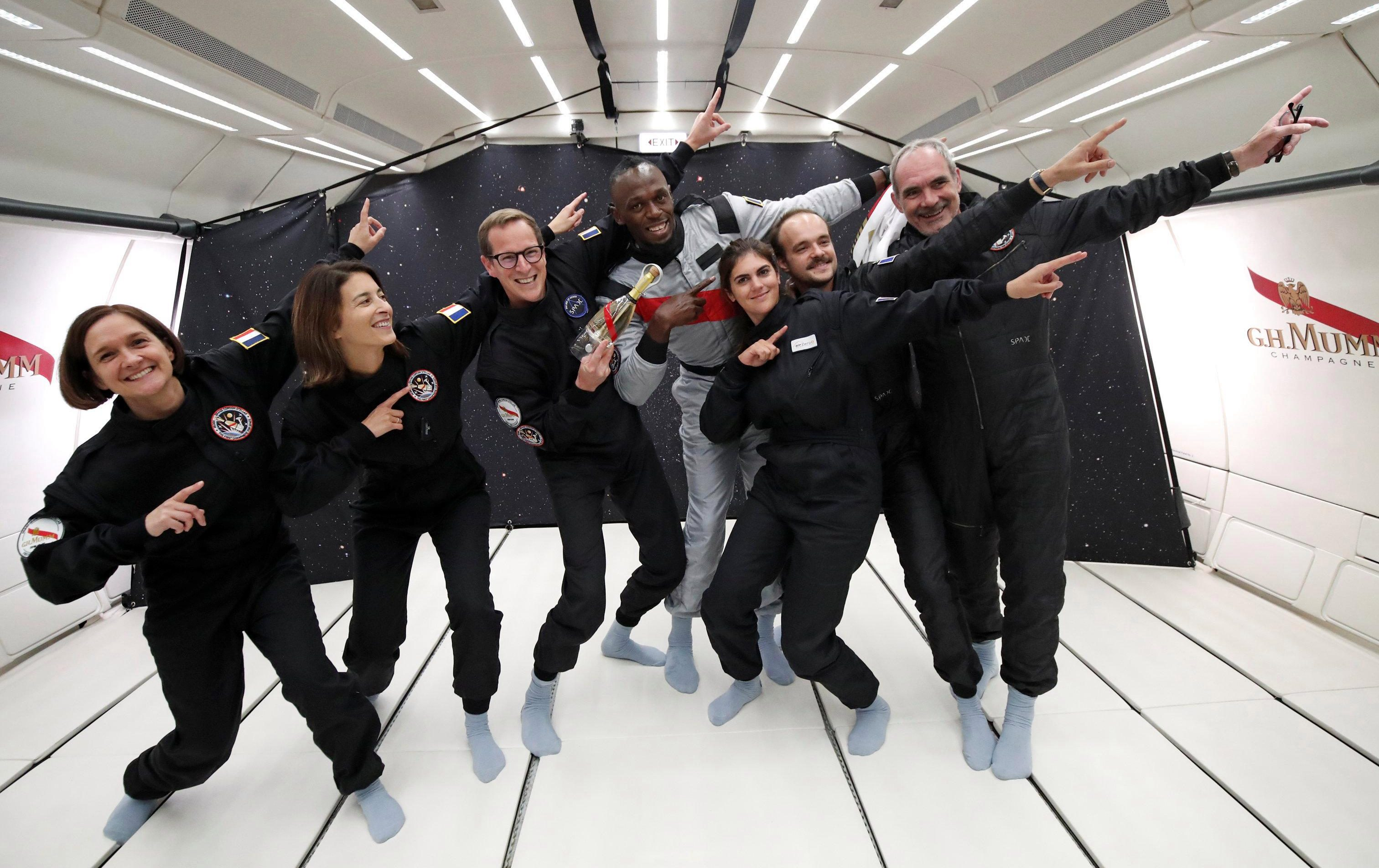 Sprinter turned footballer Usain Bolt helps his astronautical colleagues strike a pose - even without gravity