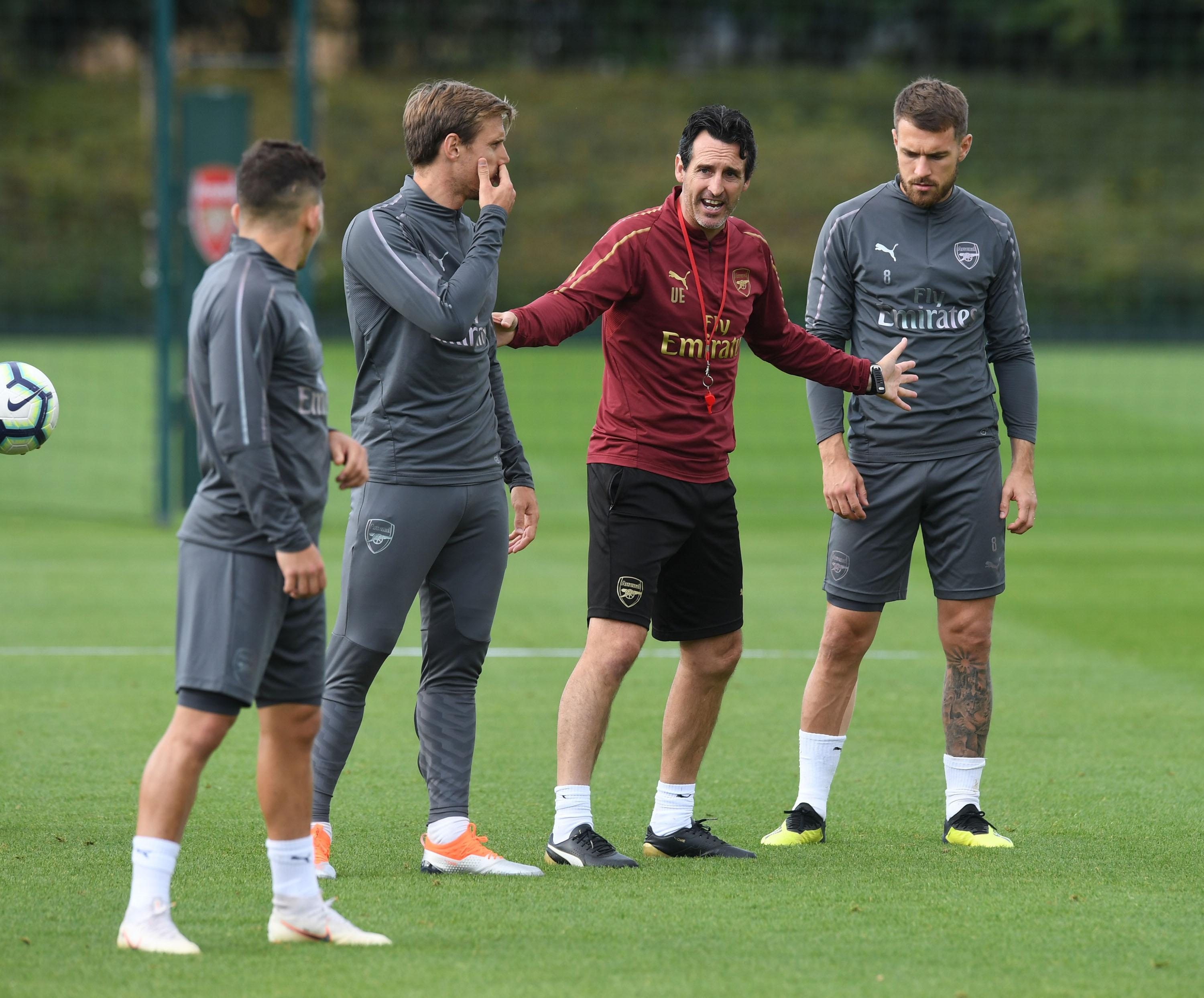 Ramsey, right, with boss Unai Emery ahead of the Gunners' trip to Newcastle today