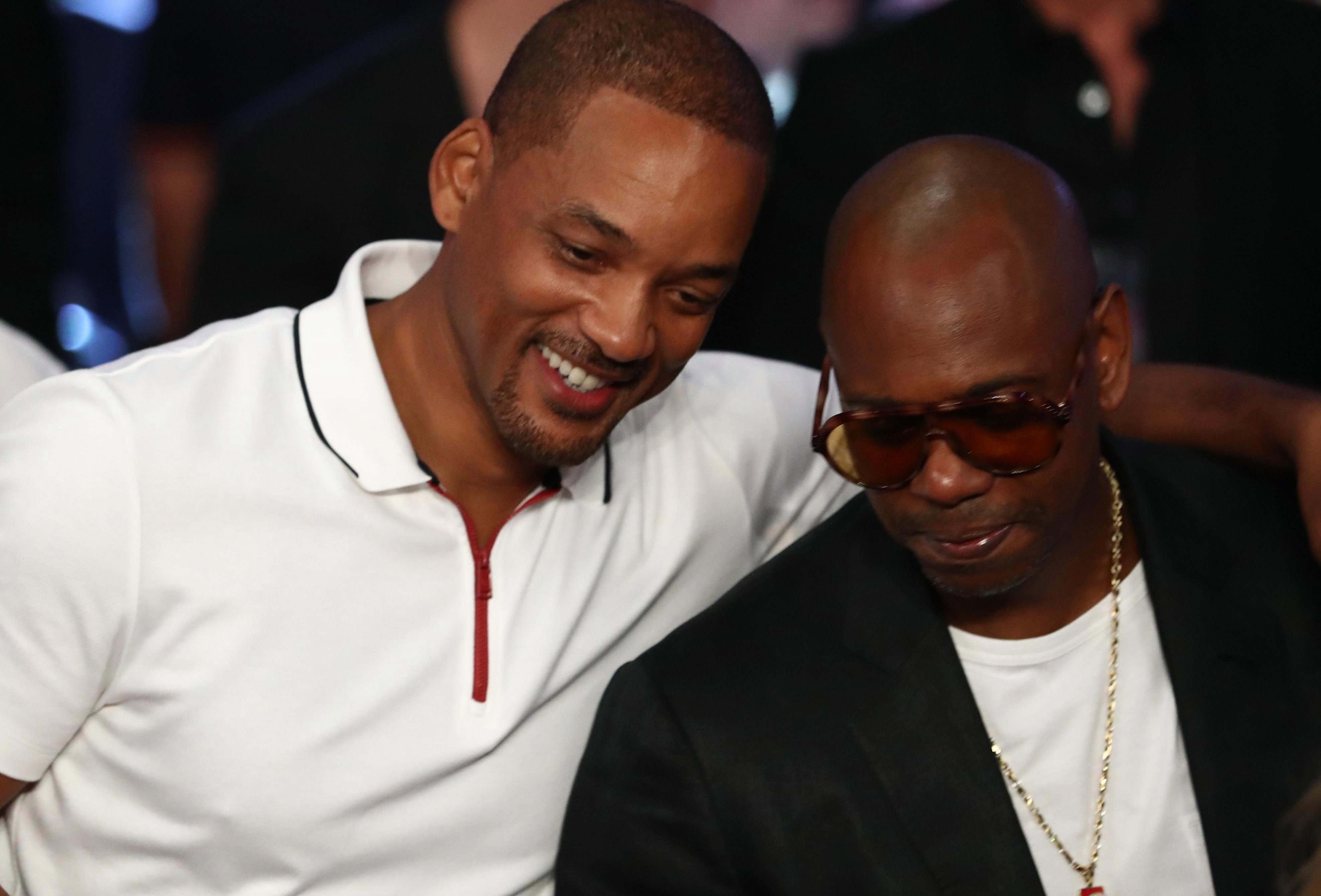 Will Smith, left, and comedian Dave Chapelle were also in attendance on the night