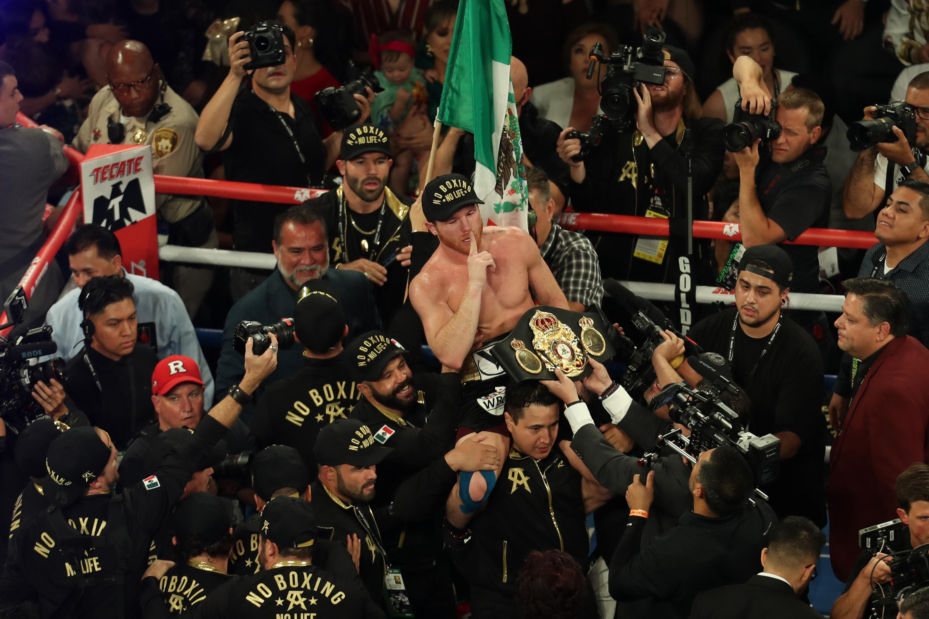 Canelo Alvarez celebrates after the final bell following his win over Gennady Golovkin