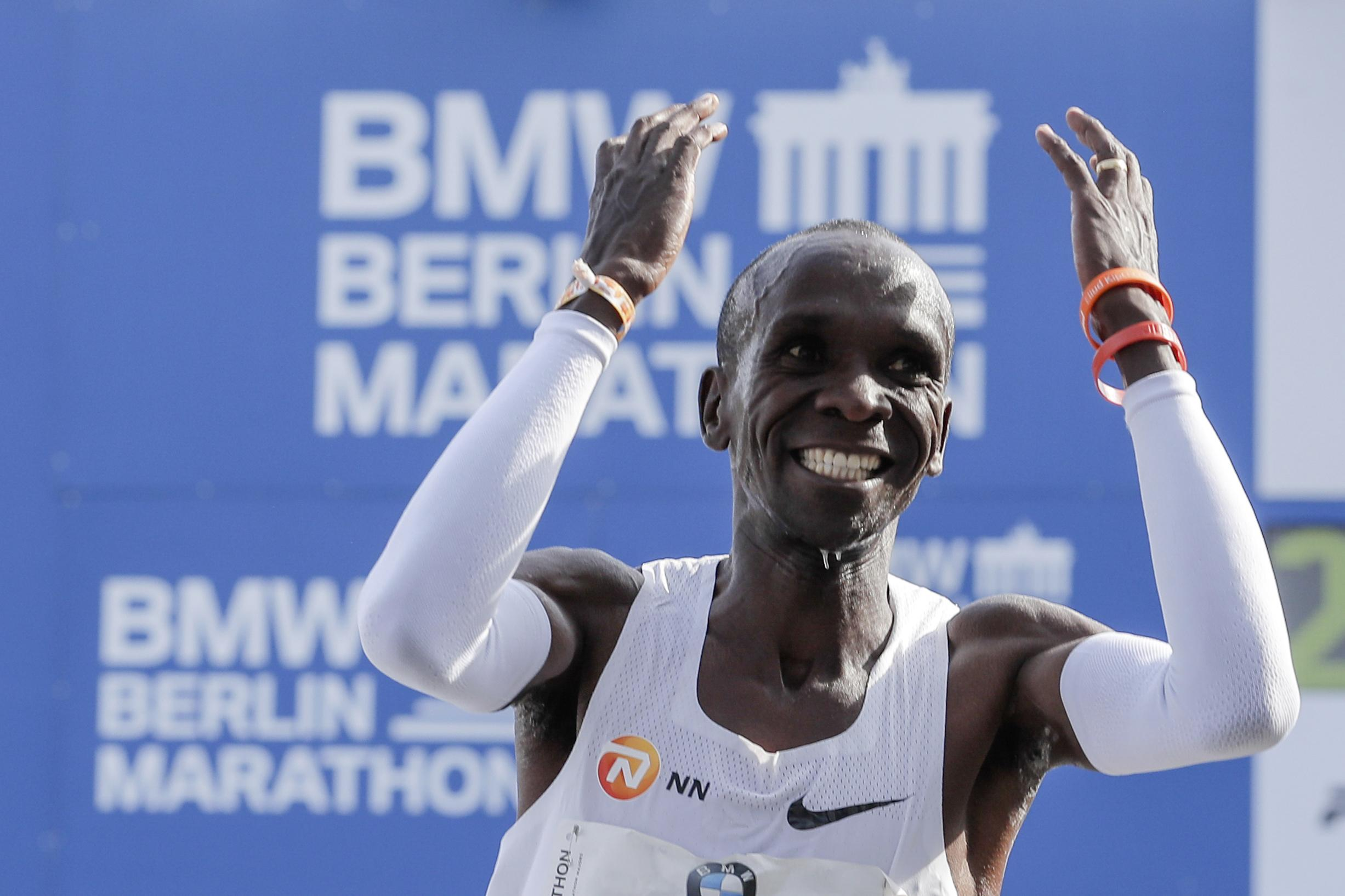 Eliud Kipchoge can hardly believe it after he breaks the world record after crossing the line in Berlin