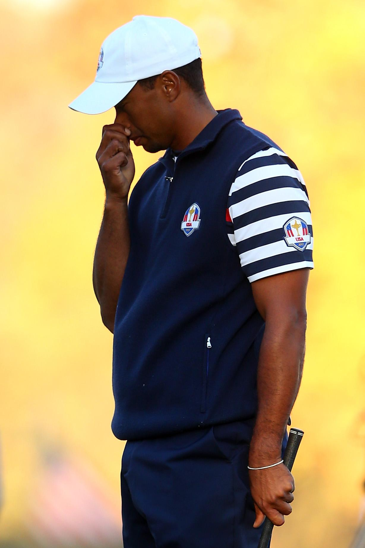 Tiger Woods suffered his first bout of back pain at the 2012 Ryder Cup