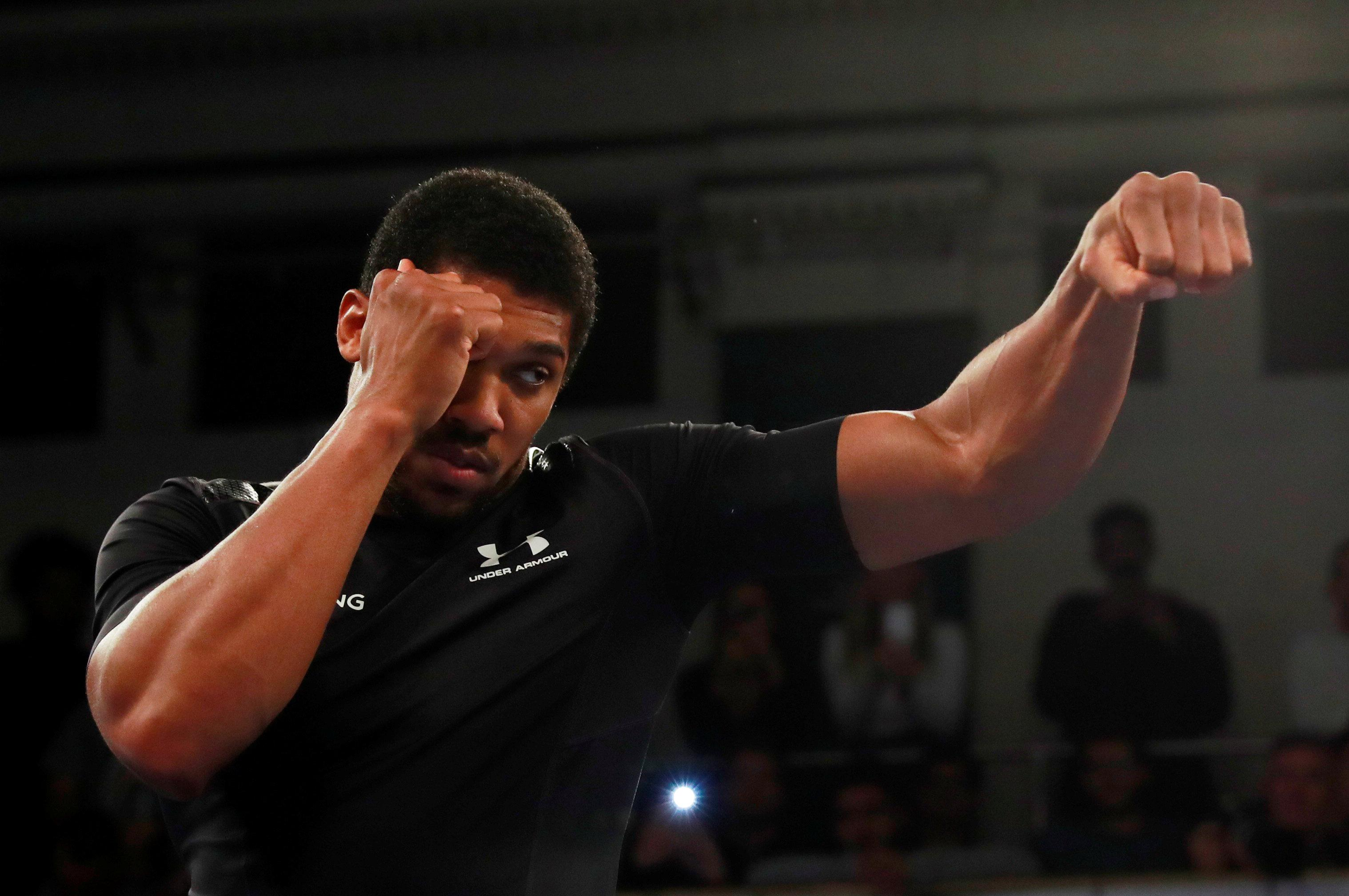 Unified world champion Anthony Joshua out to continue his unbeaten streak as he does some shadow for York Hall crowd at yesterdays public workout