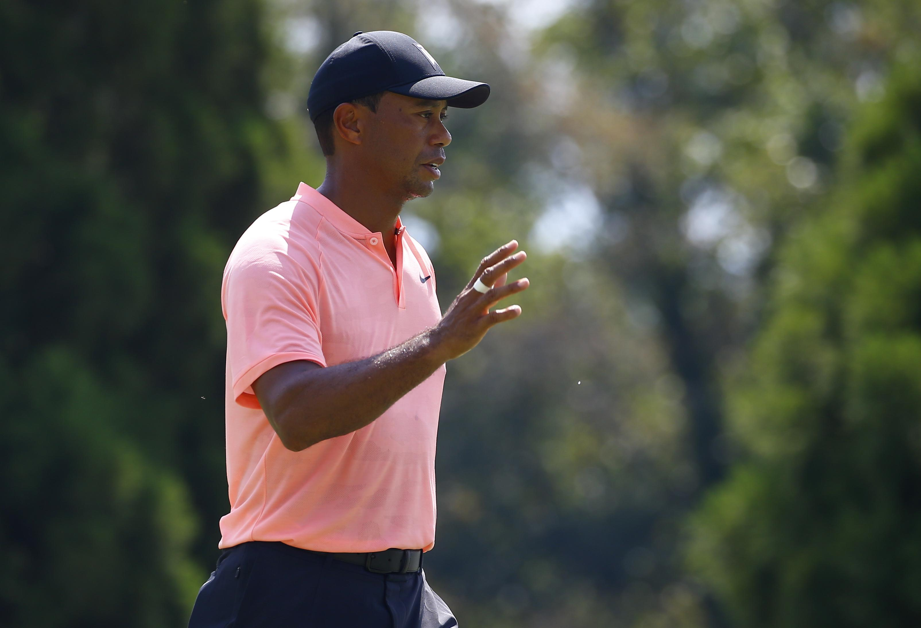 Tiger Woods looked in complete control as he shot a five under par opening round