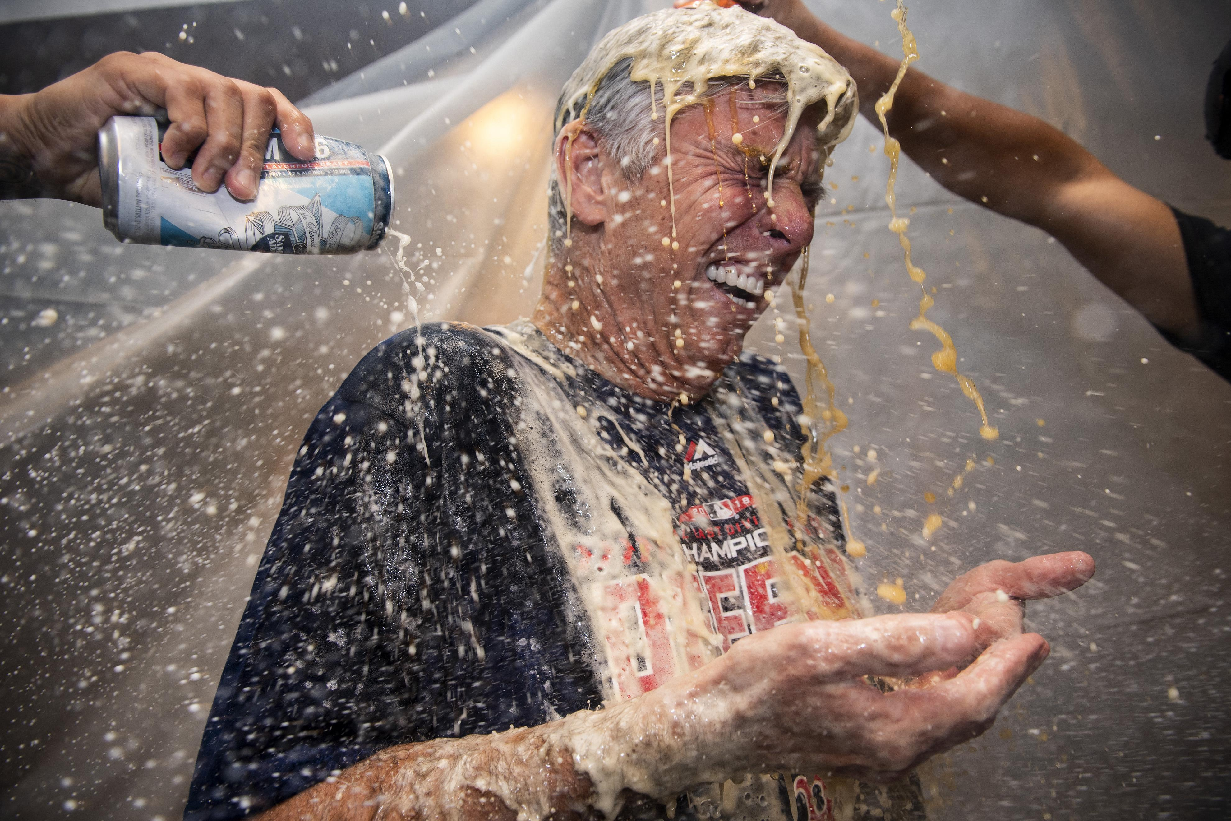 Jubilant players laugh as they celebrate winning the AL East championship