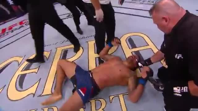 Eryk Anders collapsed to the ground in exhaustion after his defeat to Thiago Santos
