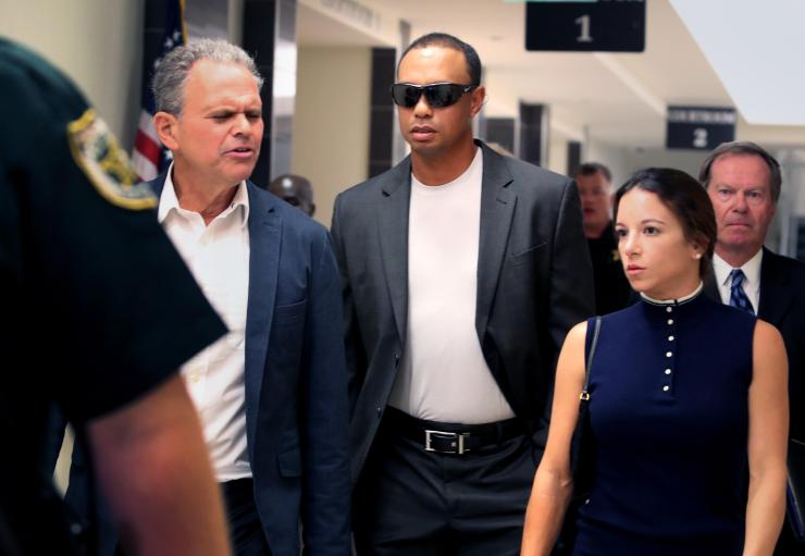 Tiger Woods and Erica leaving court in October 2017