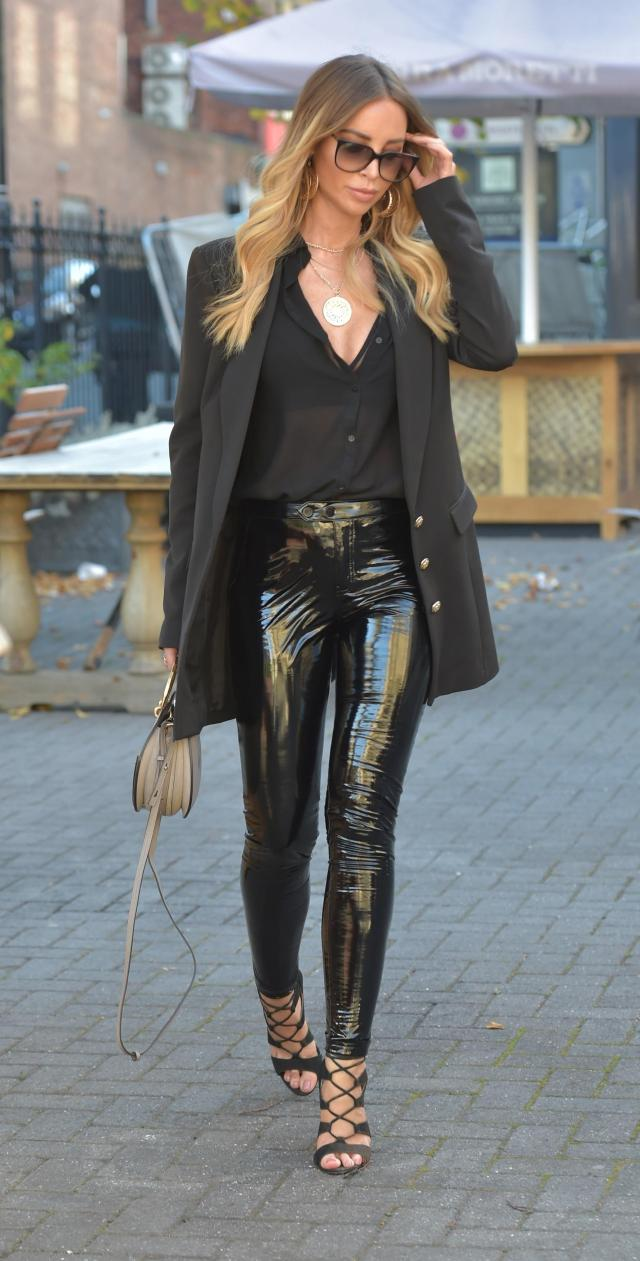 Lauren looked chic in a pair of shiny leather pants and cool sunnies