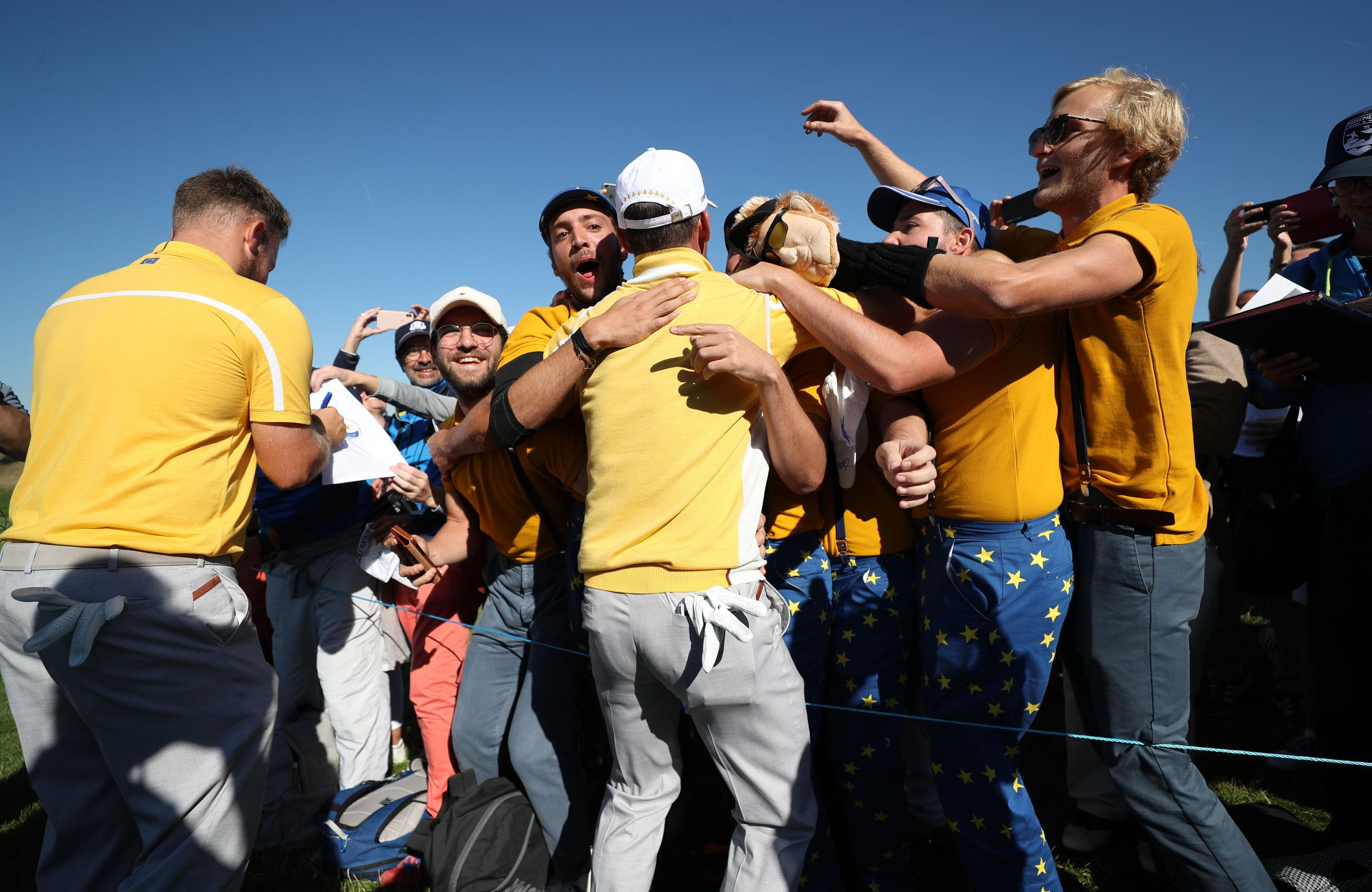 Paul Casey - making his fourth appearance at a World Cup - rejoices with the crowd