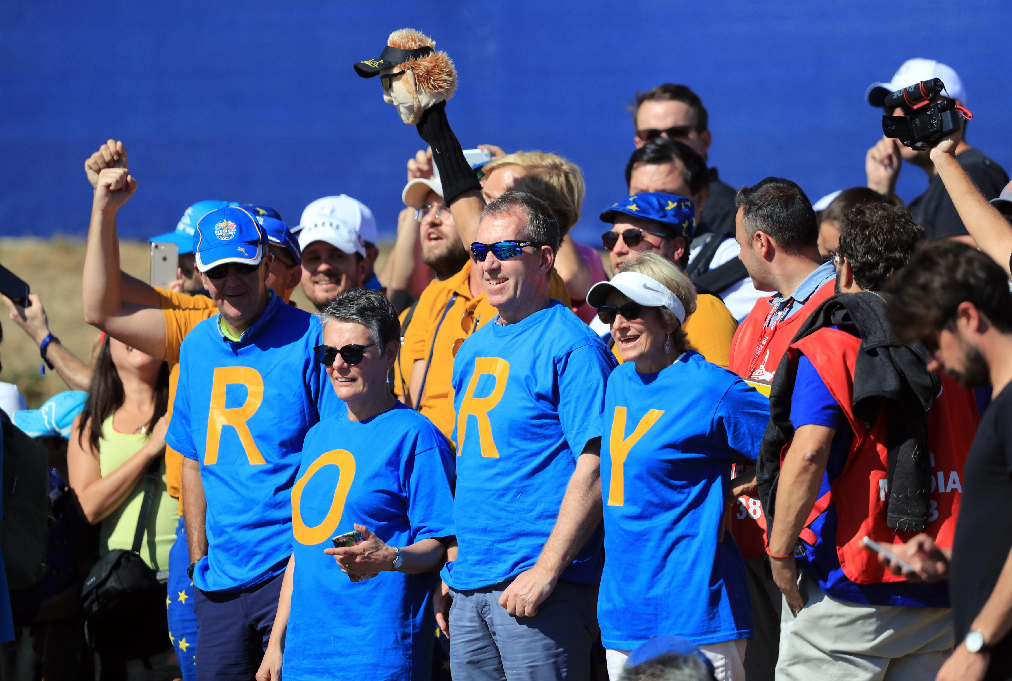 Supporters cheer on four-time major champion Rory McIlroy at Le Golf National